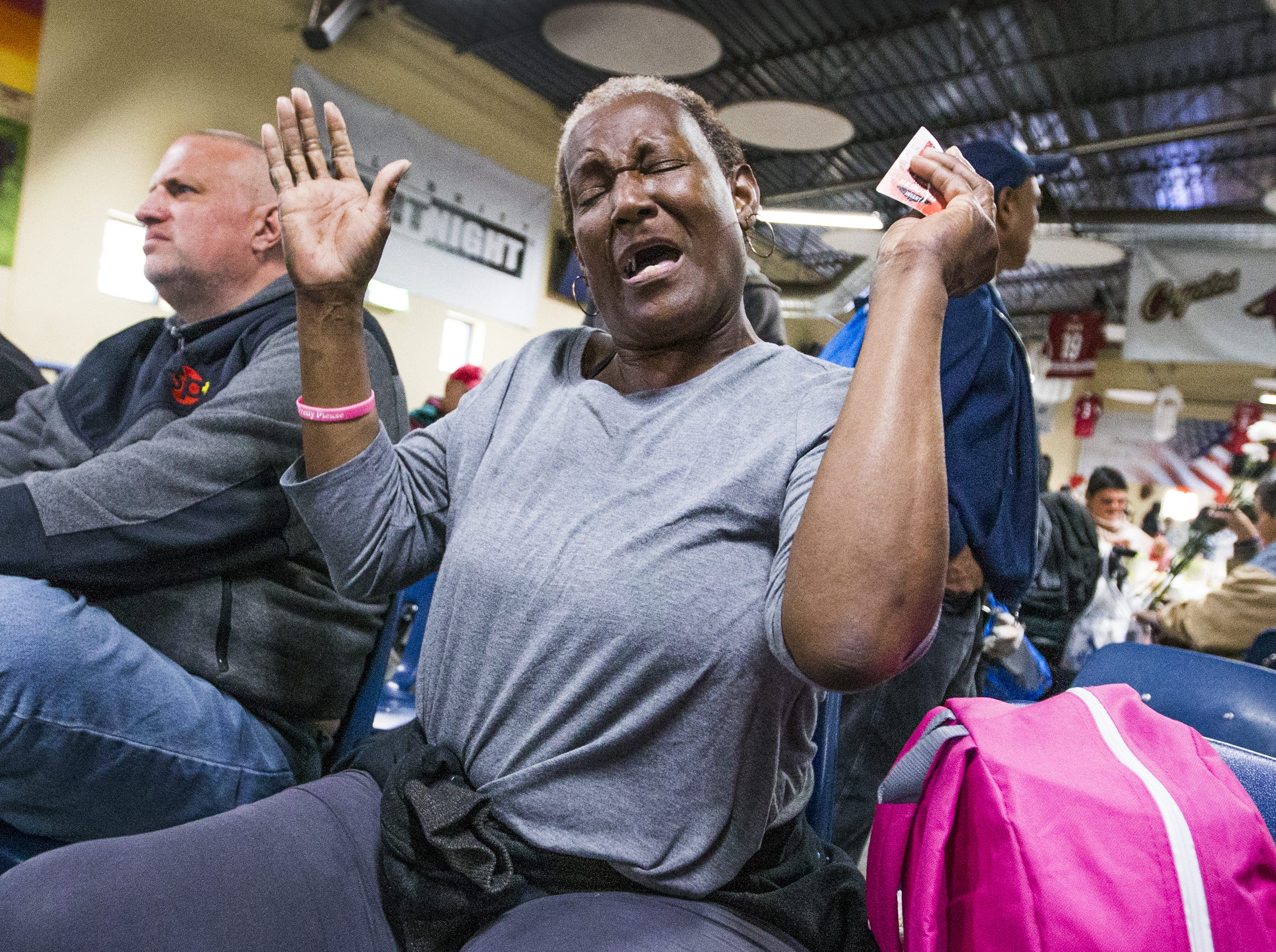 Regina Brown dances in her chair as she listens to music at the Thanksgiving Day meal served by volunteers with the St. Vincent de Paul Society. Hundreds enjoyed turkey, mashed potatoes and pumpkin pie at the Human Services Campus Dining Room in Phoenix, Thursday, November 22, 2018.
