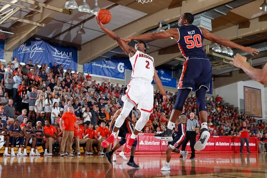 Arizona guard Brandon Williams (2) puts up a shot against Auburn center Austin Wiley (50) during the first half of  a Maui Jim Maui Invitational tournament game Nov. 21.