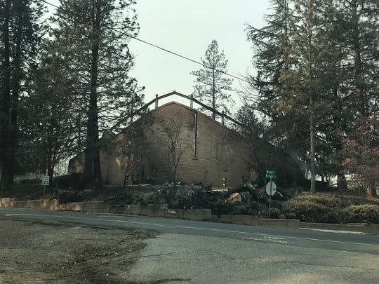 A church across the street from Paradise Cemetery burned in the fire.