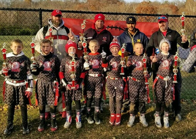 Port Clinton's 9-under flag football team won regional to qualify for the national championships. Team members include, front row left to right, Grant Periat, Beckett Mizener, Brody Bollinger, Cameron Borror, Elliot Laird, Malakii Pinkelton, Wyatt Yarbrough. Assistant coach Brad Bollinger, assistant Dan Mizener, league commissioner Will Pinkelton III and head coach Greg Yarbrough are in the back row.
