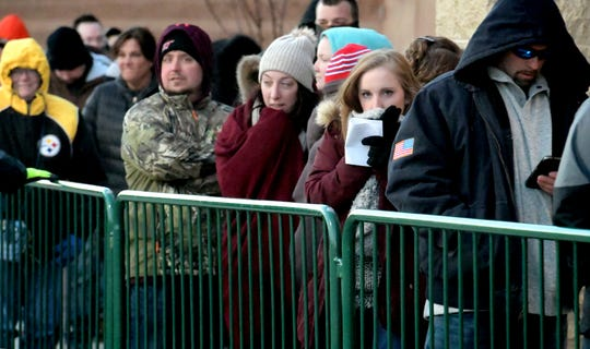 """Courtney Dippery of Dover Township tries to keep warm as she waits in line at the West Manchester Township Targeton Thanksgiving Day, Thursday, Nov. 22, 2018. The store opened at 5 p.m. She was shopping for toys for a step child. """"The things we do for love, right?"""" she said. Bill Kalina photo"""