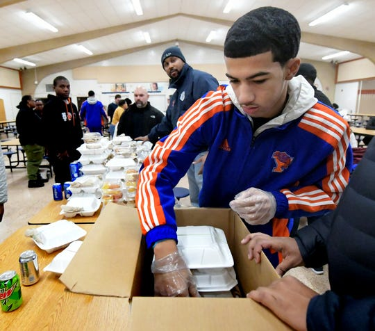 York High basketball player Dayvon Cortez packs Thanksgiving Day meals at the school's cafeteria during the York United Plate Patrol sponsored by York City School Police Thursday, Nov. 22, 2018. York City, Springettsbury and Spring Garden Township police joined school district staff, students and community volunteers to pack and deliver about 500 meals to those who needed a hot holiday meal in the York area. In addition to York City residents, people in Springettsbury Township and Spring Garden Township were eligible for meals this year. Bill Kalina photo