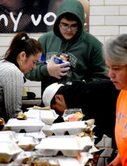 Volunteers pack Thanksgiving Day meals at the York High cafeteria and deliver them during the York United Plate Patrol sponsored by York City School Police Thursday, Nov. 22, 2018. York City, Springettsbury and Spring Garden Township police joined school district staff, students and community volunteers to pack and deliver about 500 meals to those who needed a hot holiday meal in the York area. In addition to York City residents, people in Springettsbury Township and Spring Garden Township were eligible for meals this year. Bill Kalina photo
