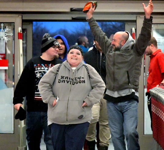 BJ Harris, of Thomasville, center, her son Trent Shelly, of York City, left, and friend Brad Markle, of West York, celebrate being the first to enter the West Manchester Township Target after it opened on Thanksgiving Day, Thursday, Nov. 22, 2018. The store opened at 5 p.m. and the trio was in line before 11 a.m. Bill Kalina photo