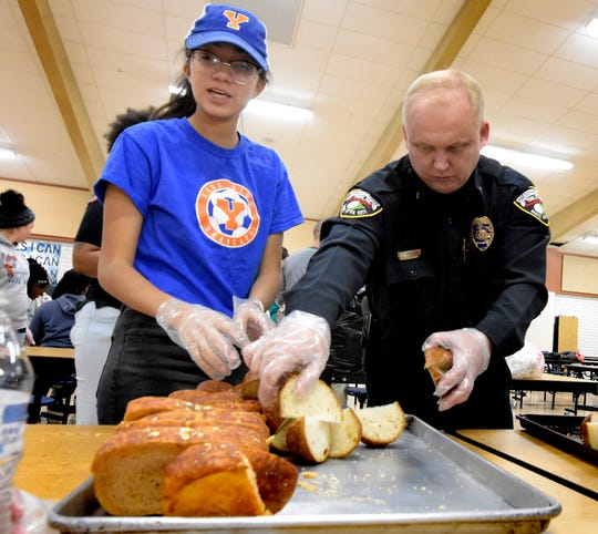 York City Police Chief Troy Bankert packs Thanksgiving Day meals with York High junior Emily Vergara at the school's cafeteria during the York United Plate Patrol sponsored by York City School Police Thursday, Nov. 22, 2018. York City, Springettsbury and Spring Garden Township police joined school district staff, students and community volunteers to pack and deliver about 500 meals to those who needed a hot holiday meal in the York area. In addition to York City residents, people in Springettsbury Township and Spring Garden Township were eligible for meals this year. Bill Kalina photo