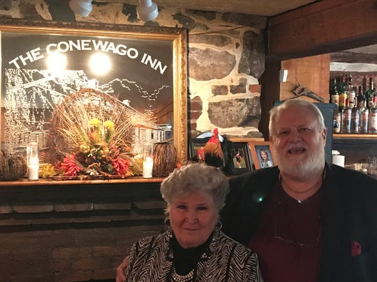 Owners of The Conewago Inn, Tom and Sharon Roberts, take a break to pose during a Thanksgiving buffet on Thursday, Nov. 22, 2018.