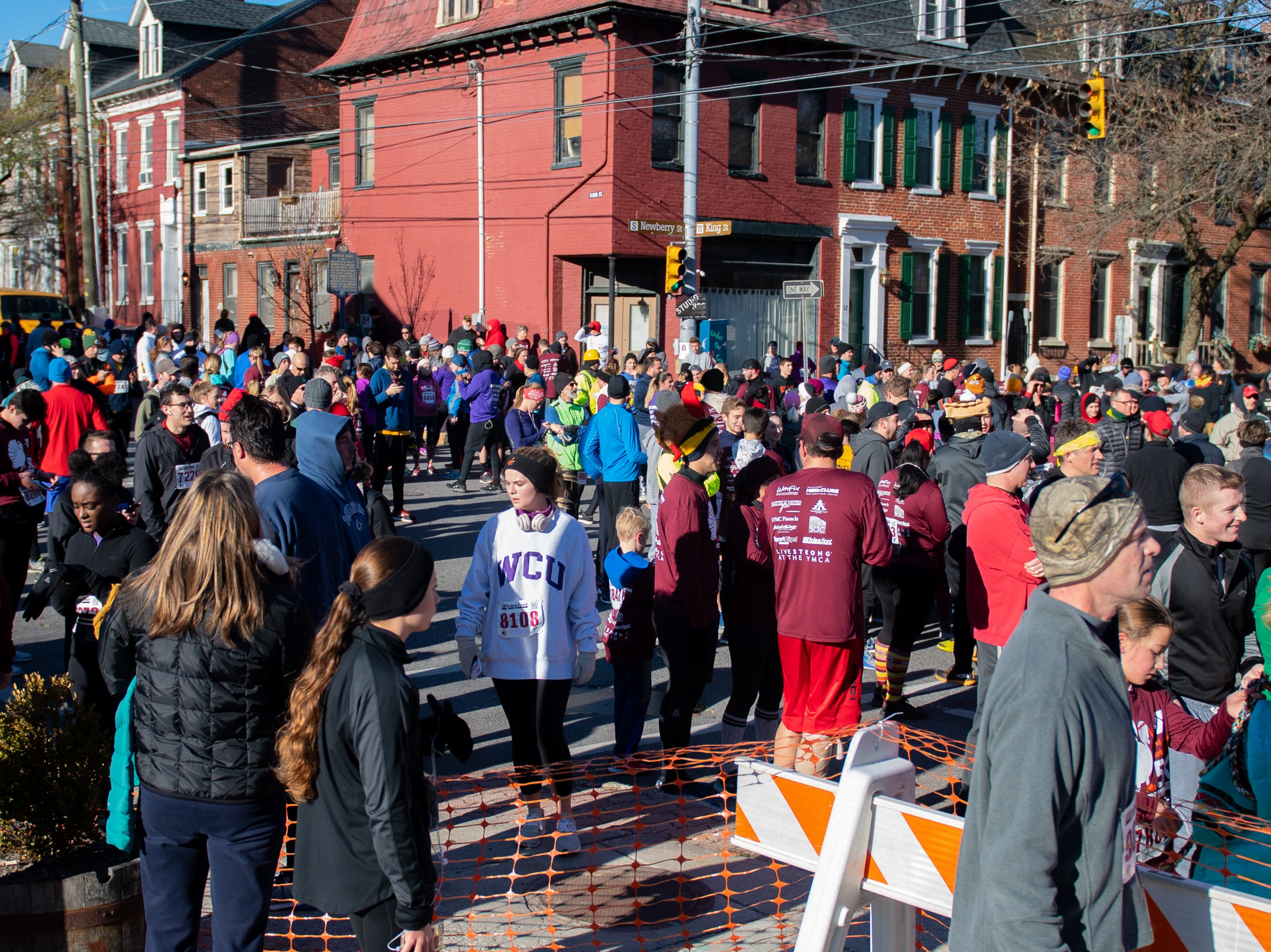 Racers wait at the finish line during the 22nd Annual Turkey Trot 5K, on Thanksgiving Day, November 22, 2018.