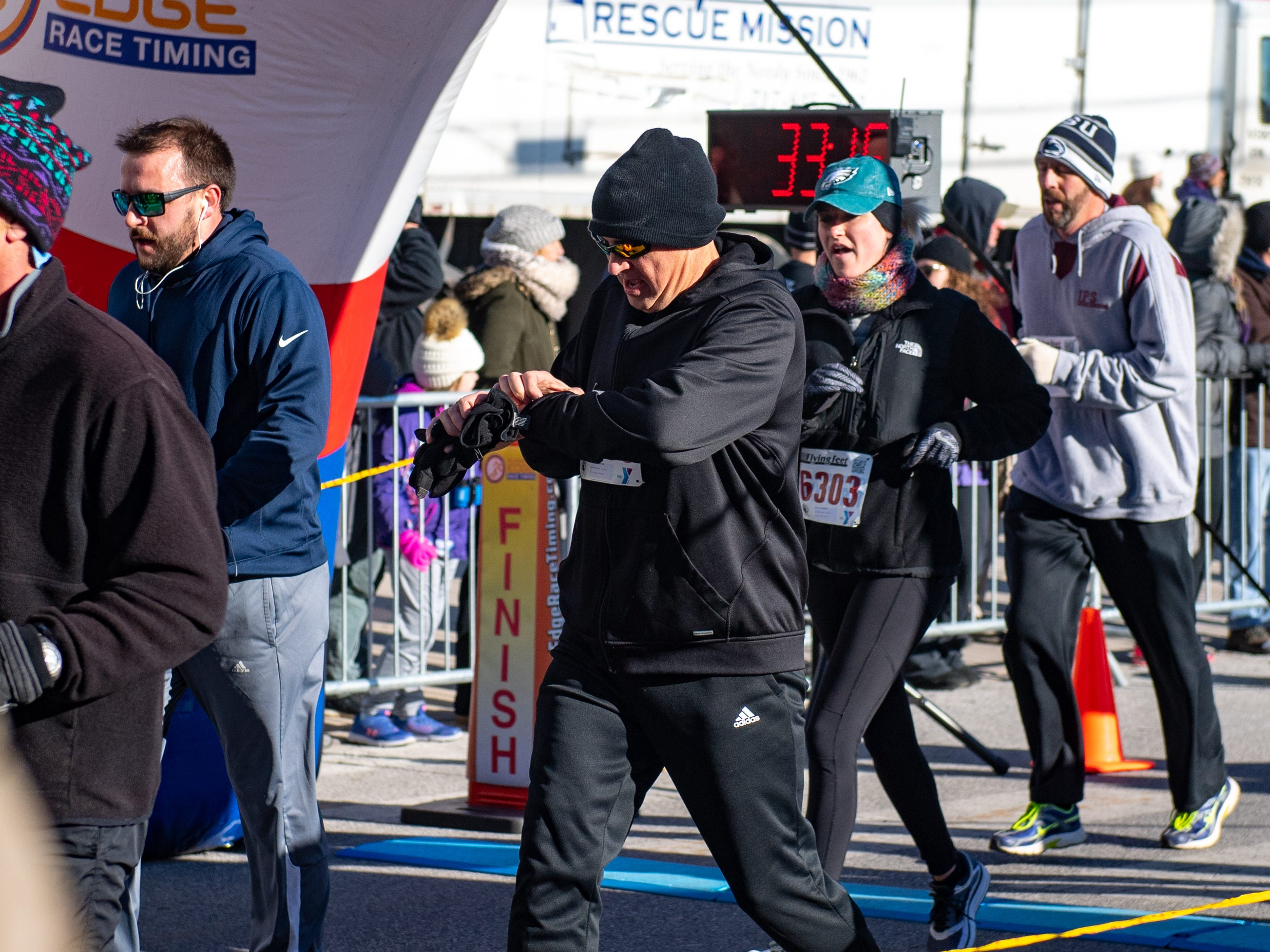 Participants cross the finish line during the 22nd Annual Turkey Trot 5K, on Thanksgiving Day, November 22, 2018.