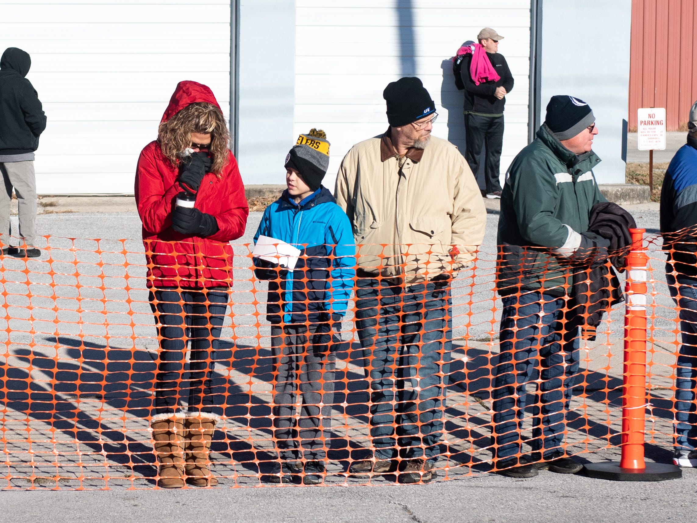 Onlookers spectate from the side of the road during the 22nd Annual Turkey Trot 5K, on Thanksgiving Day, November 22, 2018.