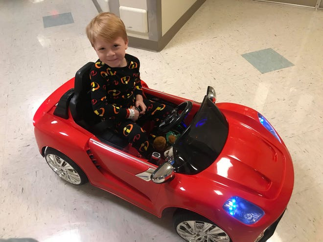 Logan Shane, 6, shows off his wheels ahead of surgery at York Hospital on Tuesday, Nov. 20, 2018. He took the maiden voyage, driving himself to the operating room. Implemented by nurse Jenn Puglisi and others, the design to to de-stress young patients without medicine before surgery. Logan's surgery for a cranioplasty was a success.