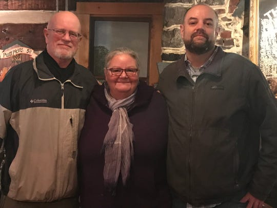 York Daily Record reporter Geoff Morrow, right, and his parents, Tom and Sue, are full after a Thanksgiving buffet at The Conewago Inn.