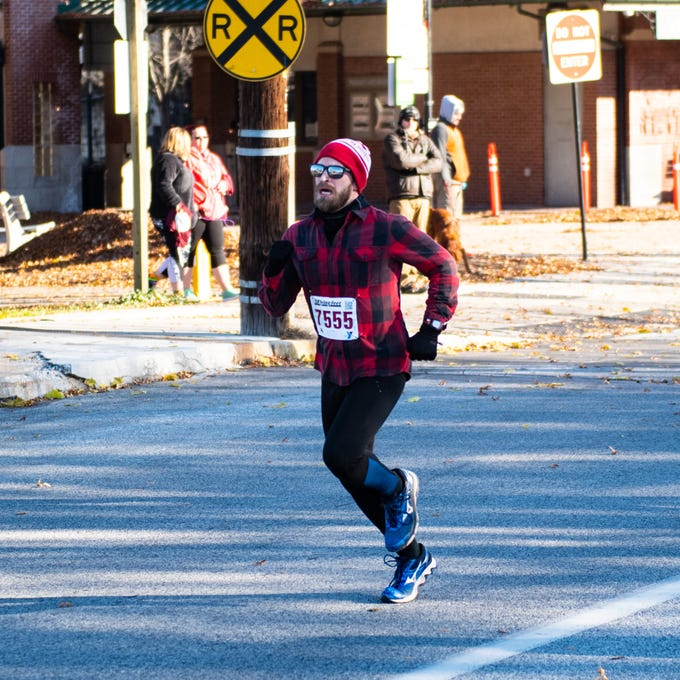 Participants run through downtown York during the 22nd Annual Turkey Trot 5K, on Thanksgiving Day, November 22, 2018.