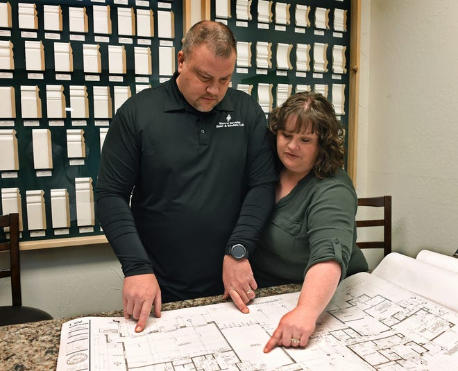 Mark and Stacey Bollinger, owners of Sierra Nevada Door & Window, look over blueprints for one of their projects on Nov. 20, 2018.