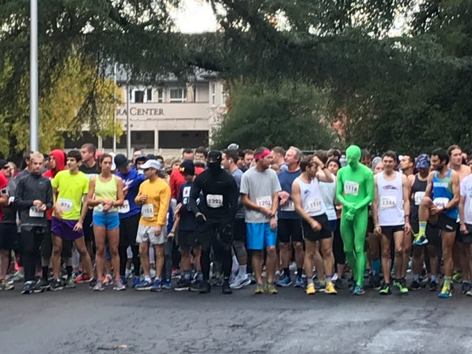 More than 640 runners, some in costume, wait for the start of the main race on Thanksgiving morning.