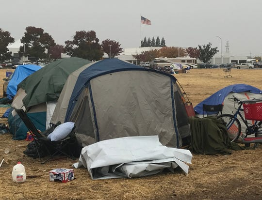 There were more than 100 people still living Wednesday at a make-shift evacuation shelter outside the Chico Walmart.