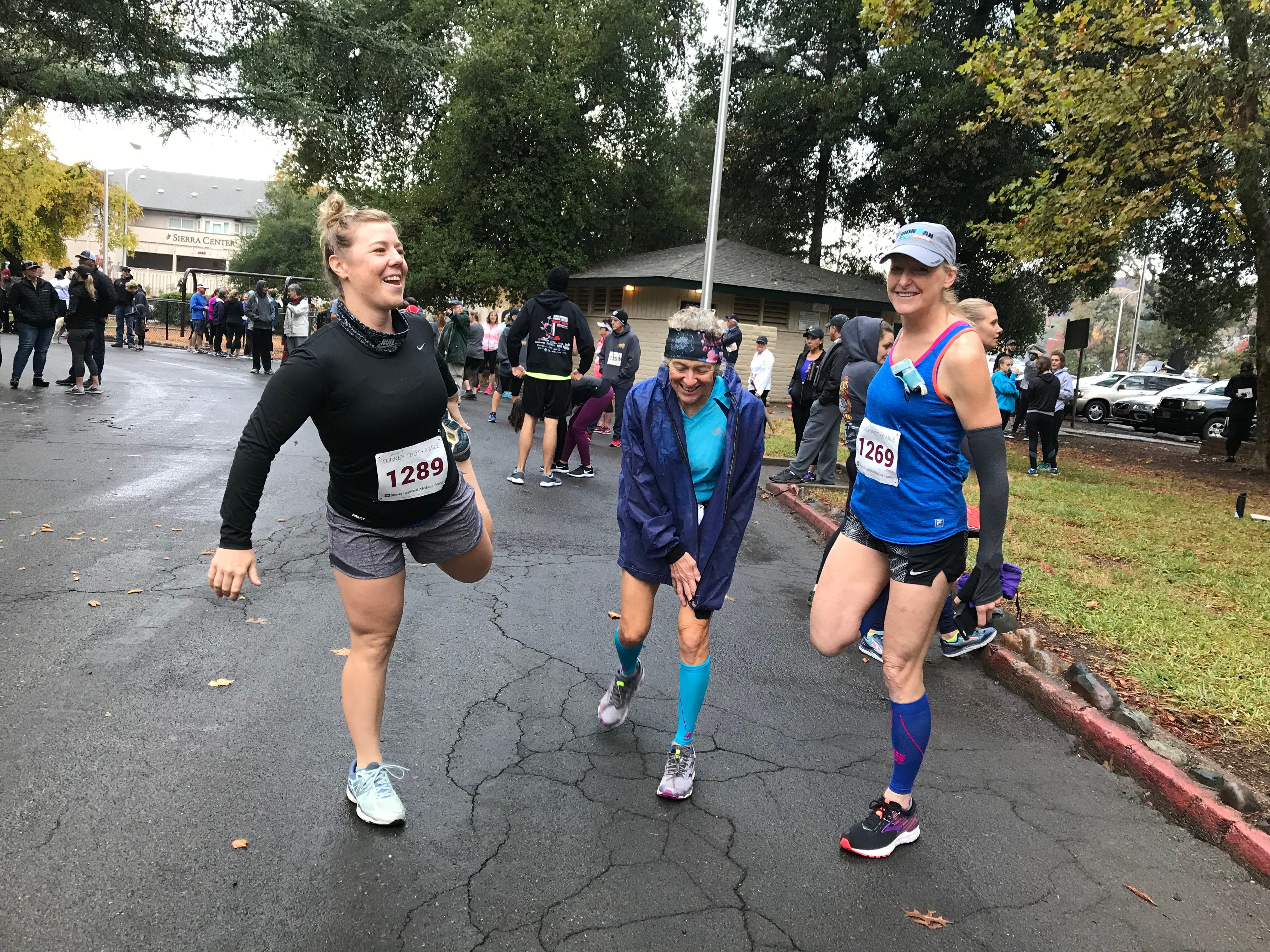 Carrie Taylor, left, warms up with Liz Friedman, center, and Lynn Holmquist before the main race.