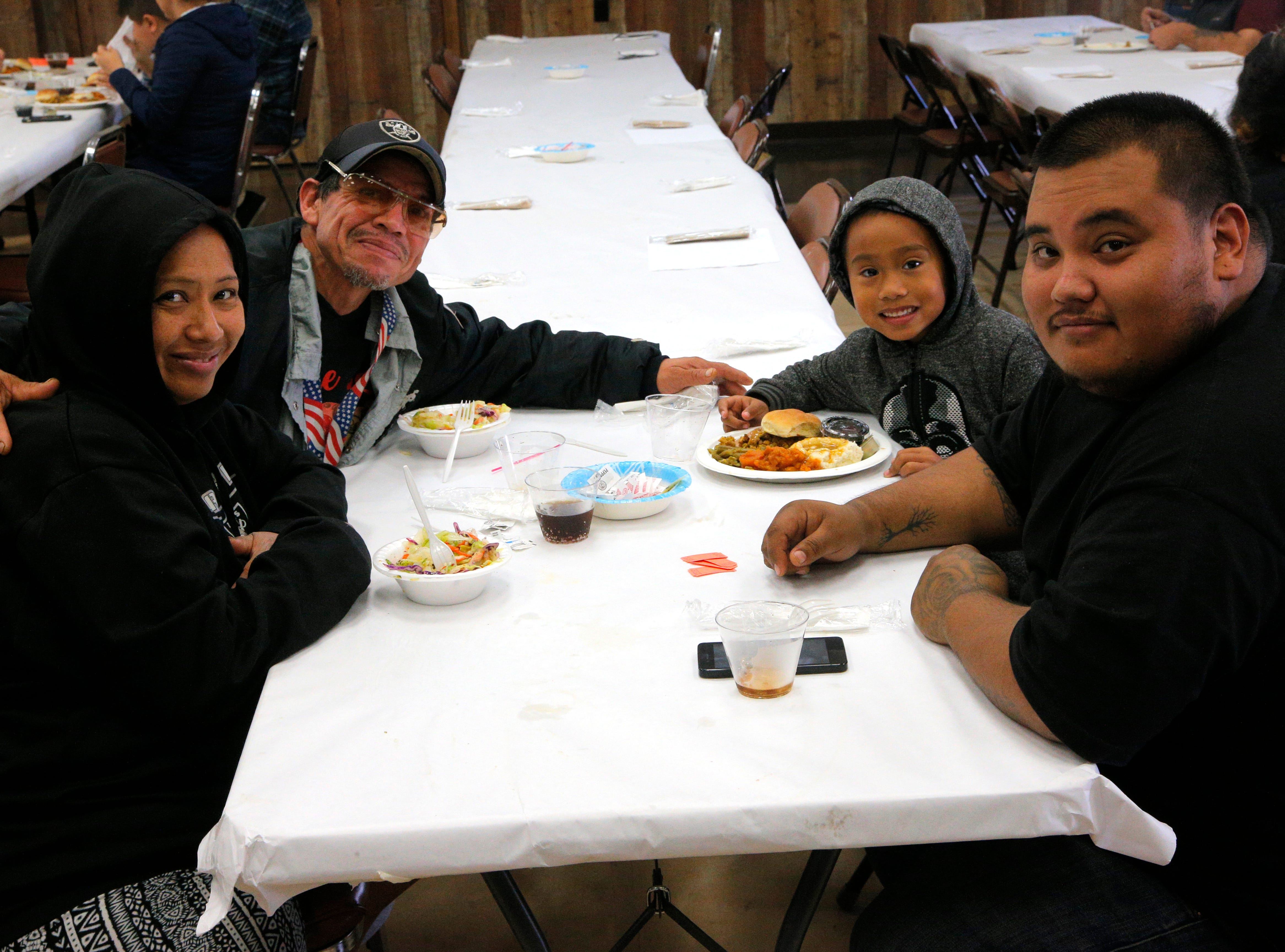From left: Lenora Gabot, Gilbert Moreno, Zephaniah Gabot, 6, and Jessie Orozco, 25, praised the food served at the American Legion Post 31 on Thanksgiving.