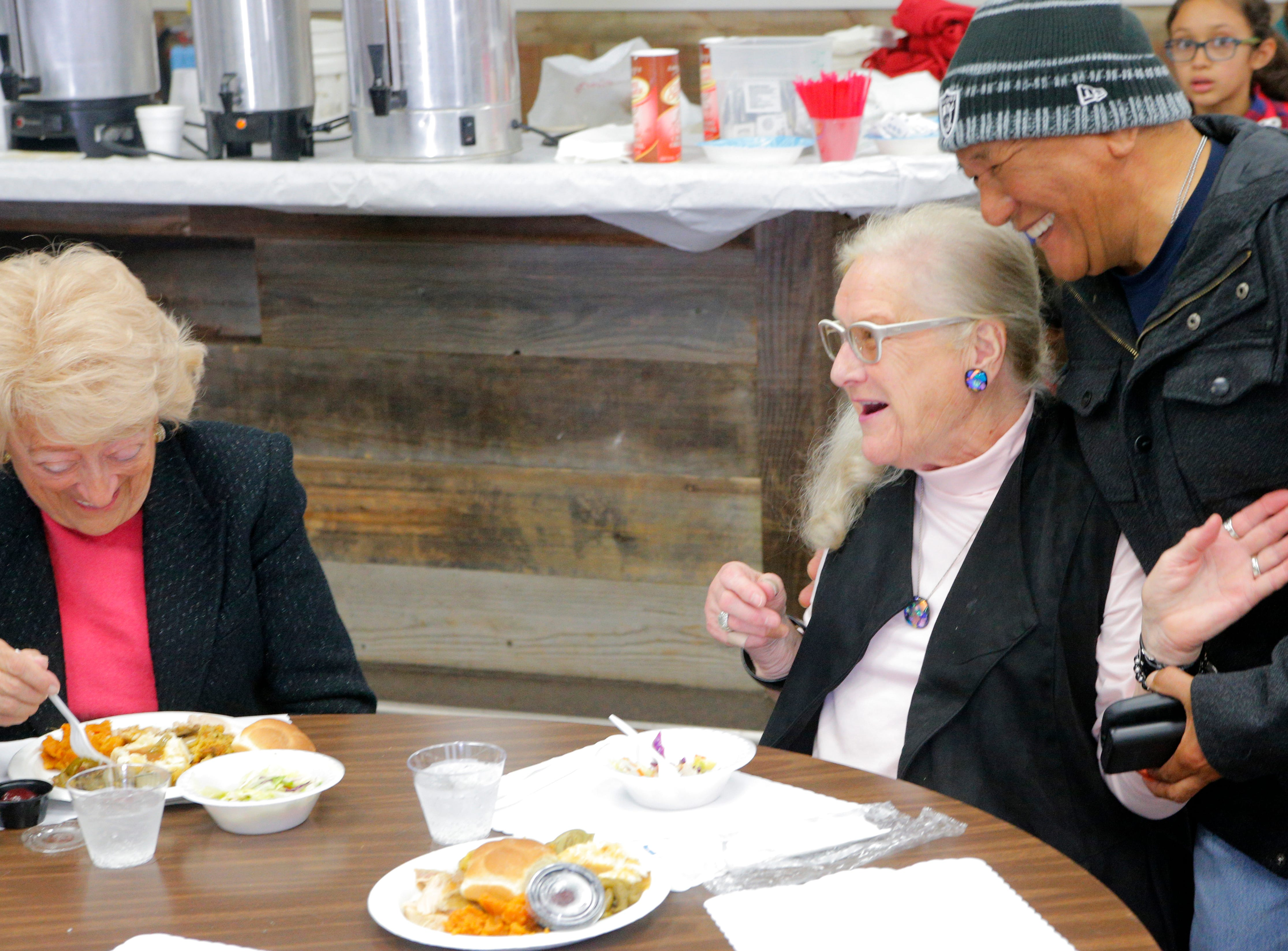 "From left: Florence Wilkinson, Ursula Pherigo and Rolando Acidera laugh while enjoying Thanksgiving Day at the American Legion Post 31. ""This is our home away from home,"" Wilkinson said."