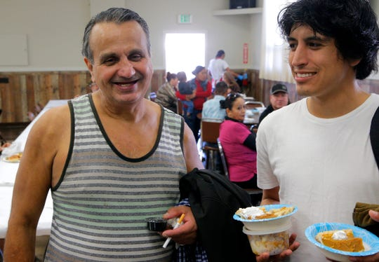 FILE: Mark Ferrel, 59, and his friend David Santana, 25, attended the free Thanksgiving Day feast at the American Legion Post 31 in Salinas, on Thanksgiving Day in 2018.