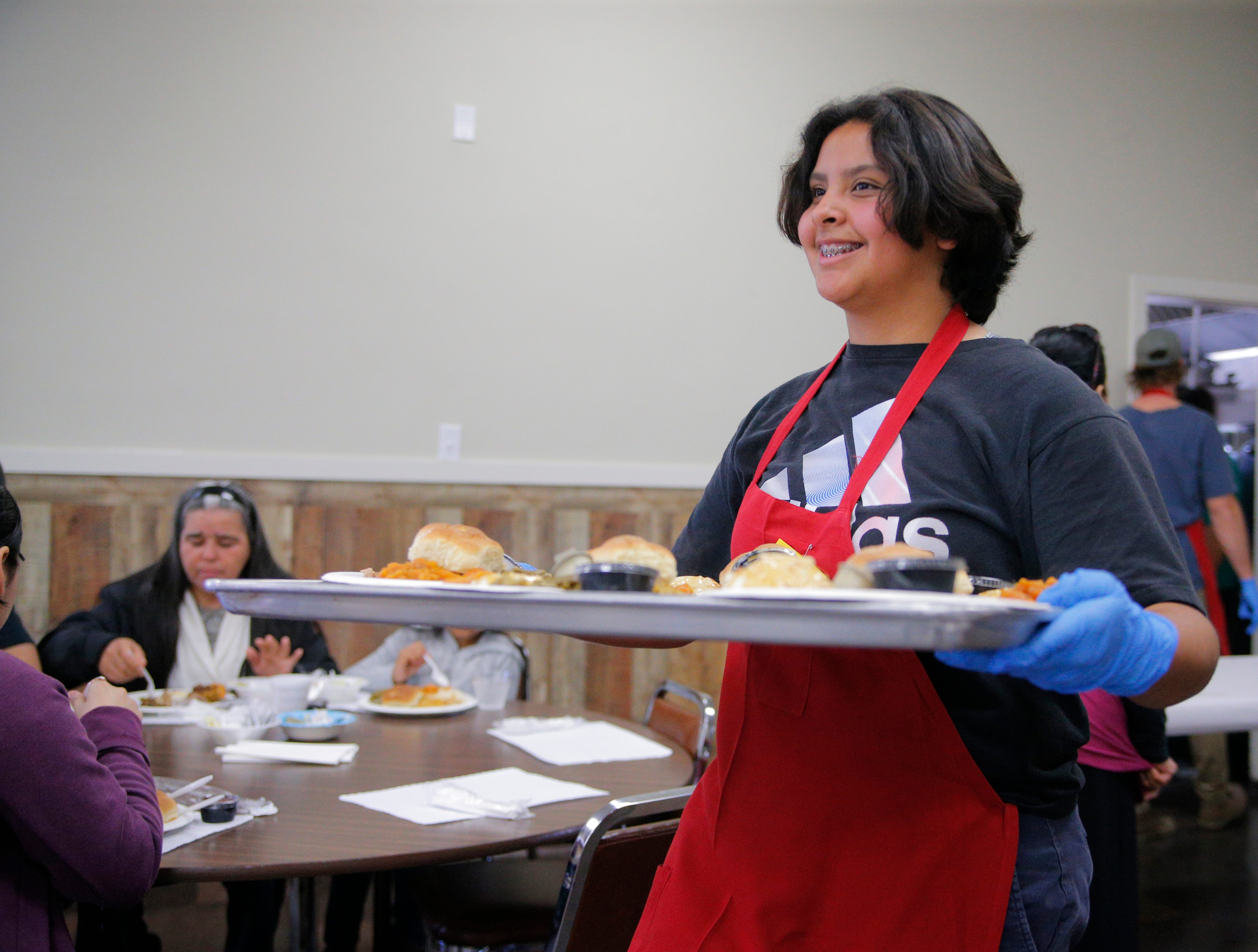 Destiny Castro serves turkey with plenty of fixings on Thanksgiving at the American Legion Post 31.