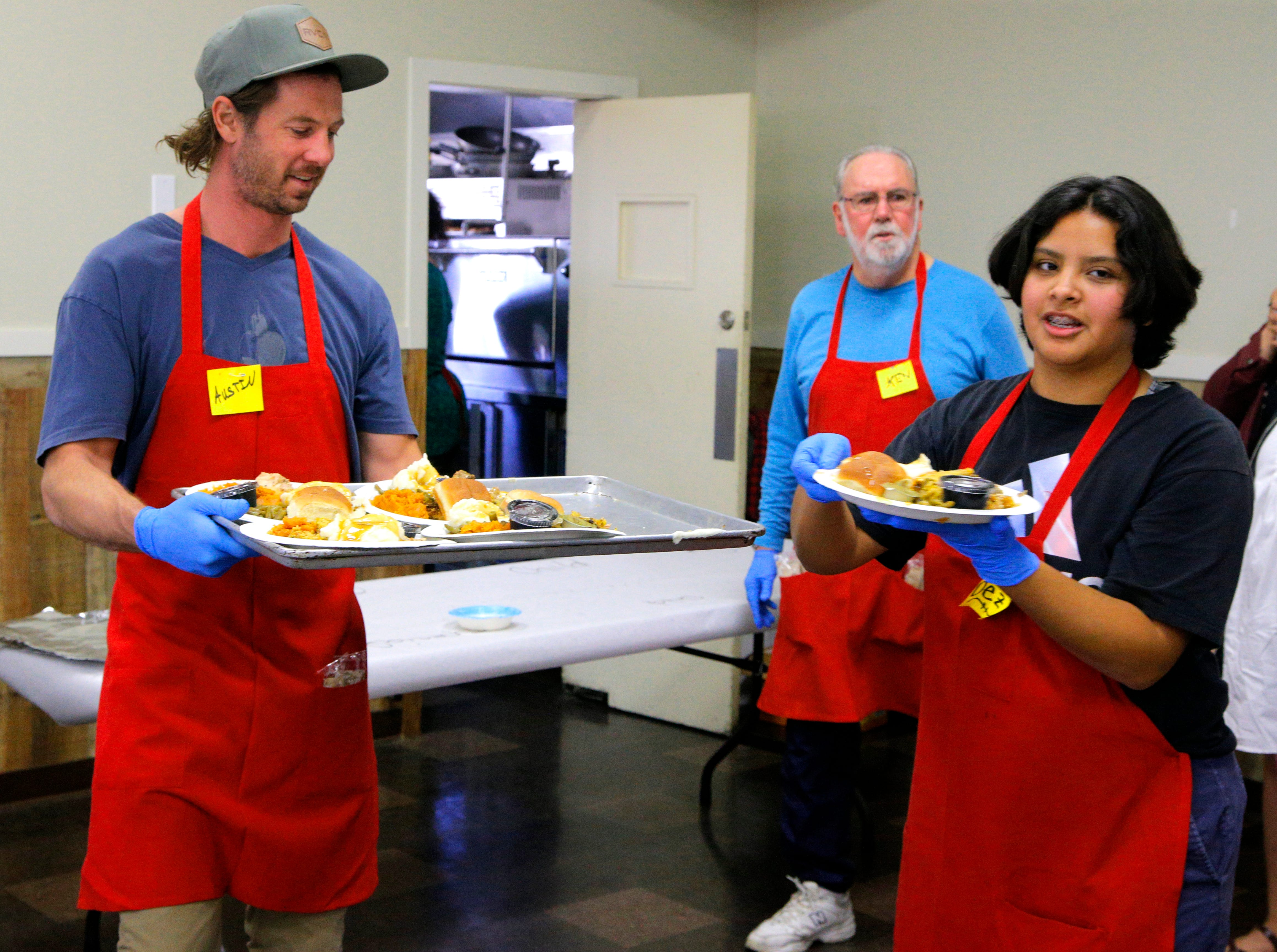 Volunteers serve food on Thanksgiving Day at the American Legion Post 31.