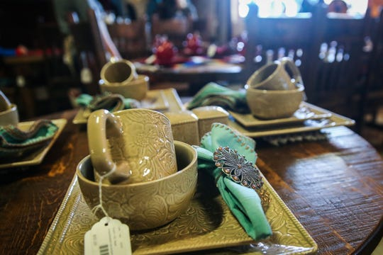 Dinnerware sets are displayed on tables Saturday, Nov. 17, 2018, at Casa Decor.