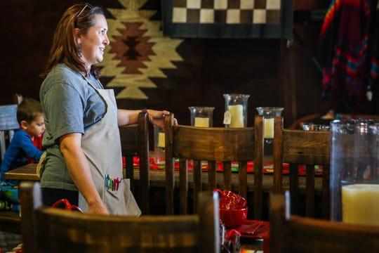 Sadie Cartwright chats with a customer Saturday, Nov. 17, 2018, at Casa Decor.