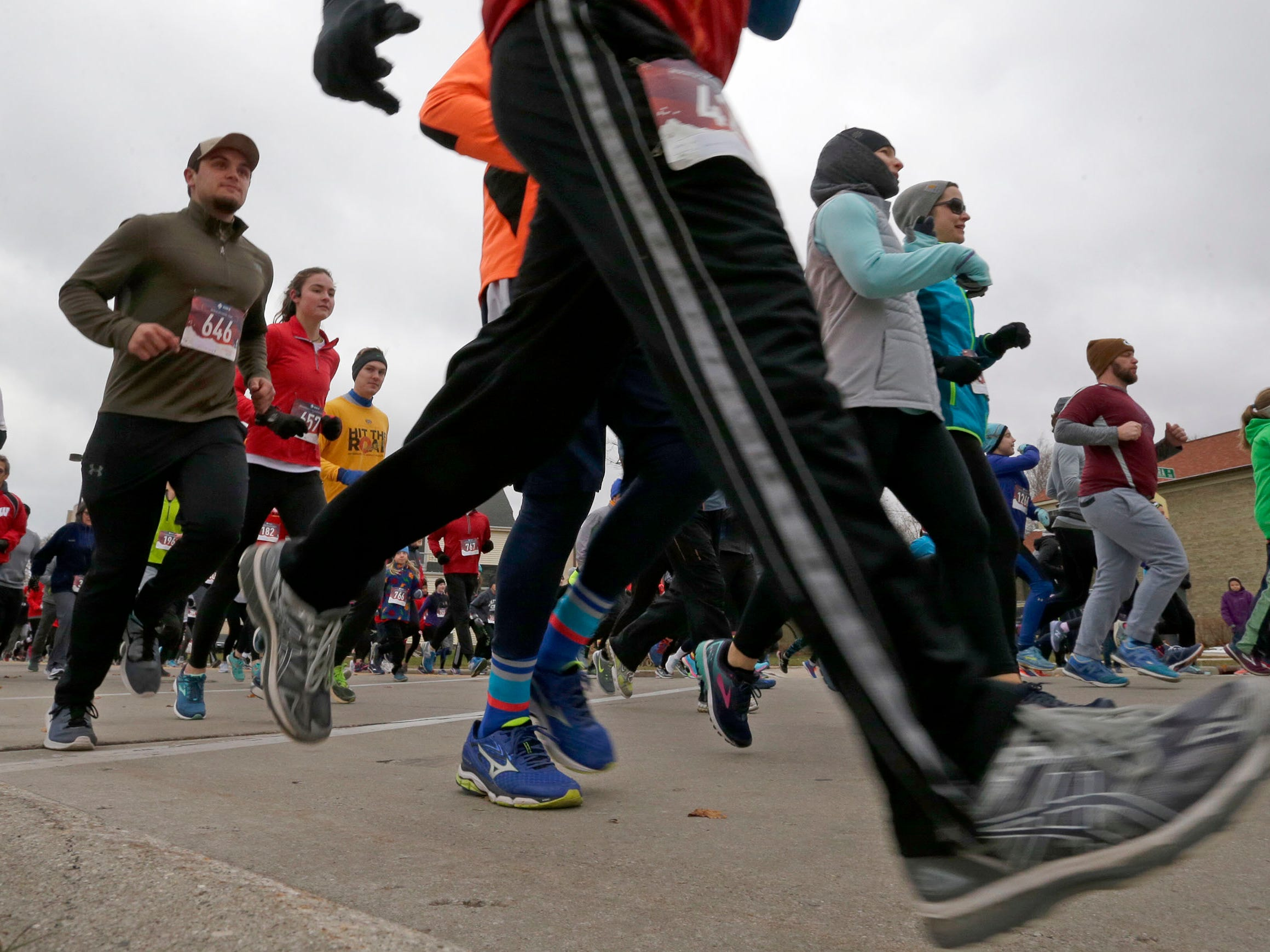 Runners at the start of the Doug Opel Run for the Kids, Thursday, November 22, 2018, in Sheboygan, Wis.