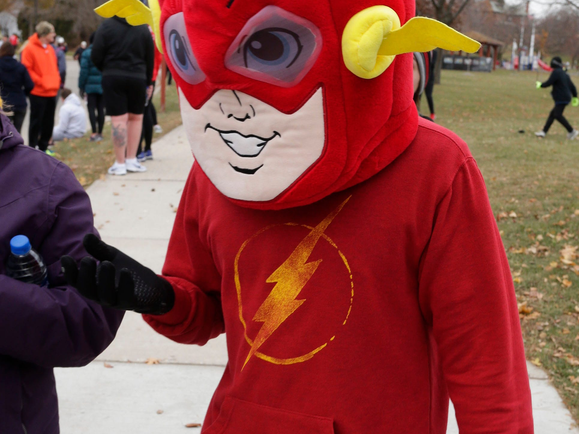 Even a superhero participated at the Doug Opel Run for the Kids, Thursday, November 22, 2018, in Sheboygan, Wis.
