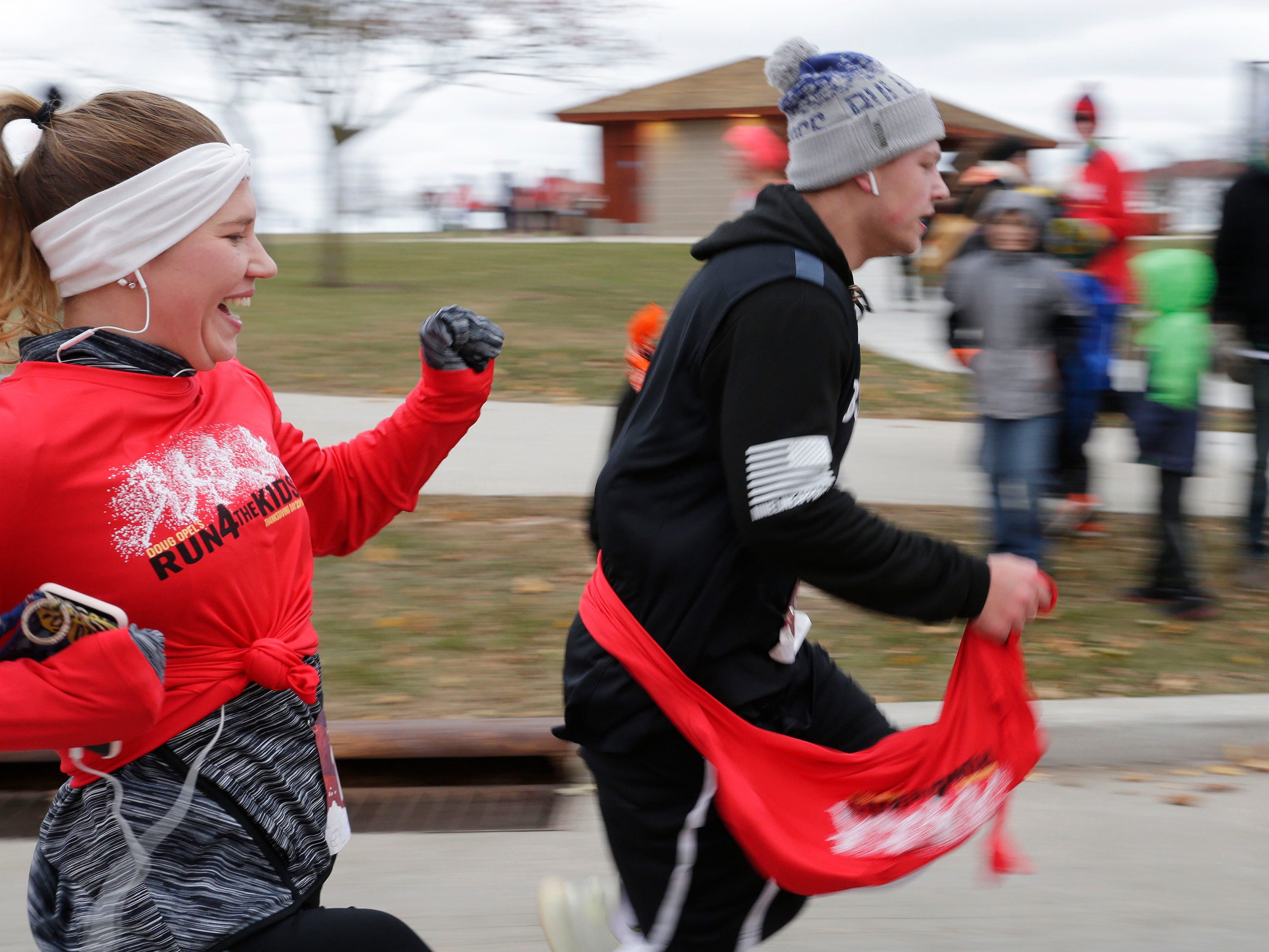 Smiles and sprints were common at the end of the Doug Opel Run for the Kids, Thursday, November 22, 2018, in Sheboygan, Wis.