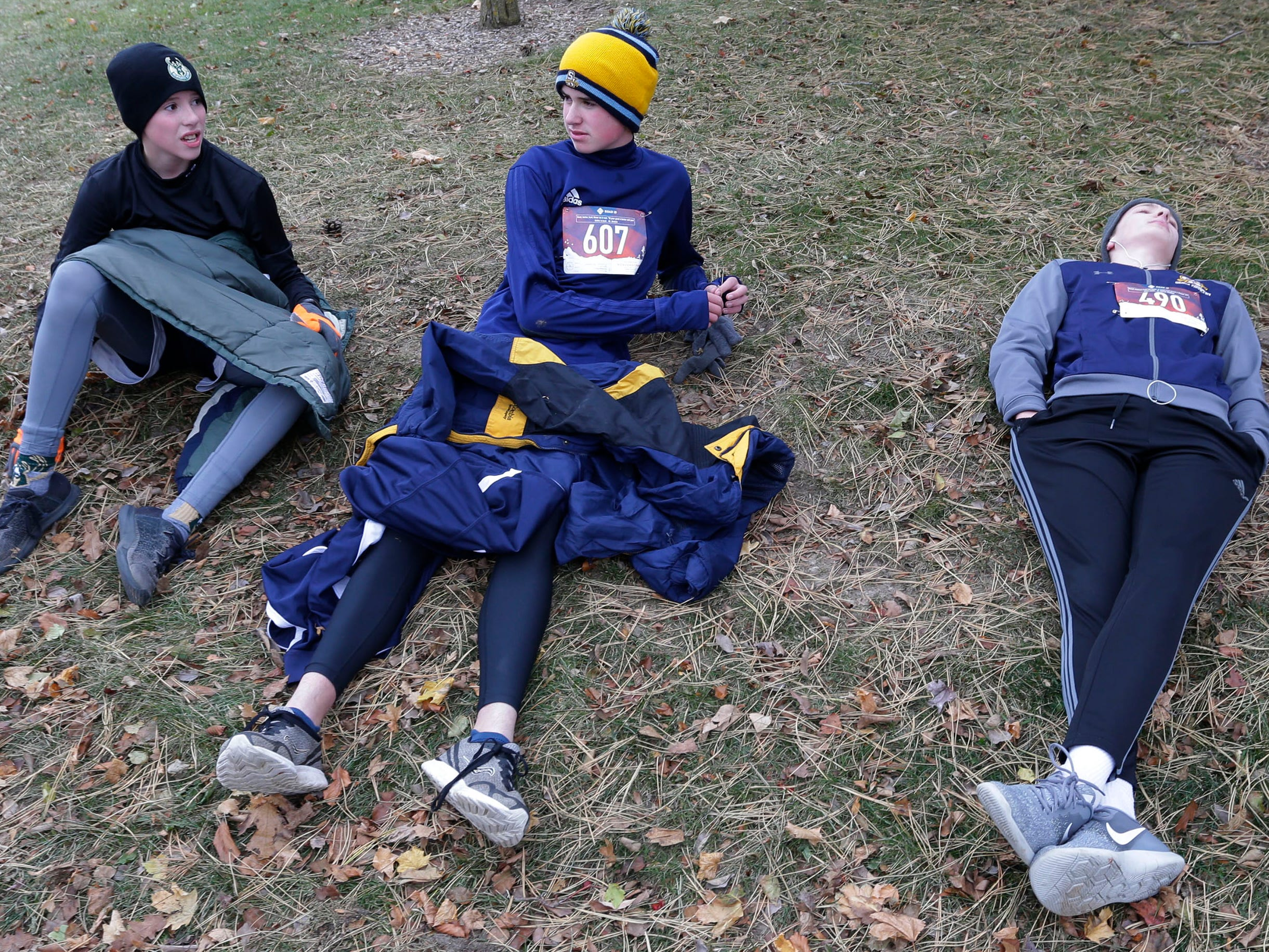 Greg Pittner, left, Chris Pittner, middle and Joseph Basler rest after completing the Doug Opel Run for the Kids, Thursday, November 22, 2018, in Sheboygan, Wis.