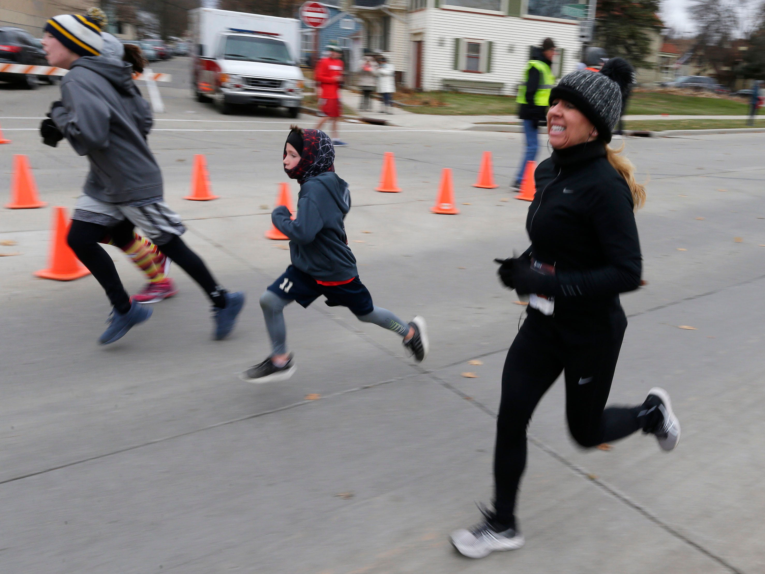 Wendy Klein of Sheboygan, Wis, right, runs during the Doug Opel Run for the Kids, Thursday, November 22, 2018, in Sheboygan, Wis.