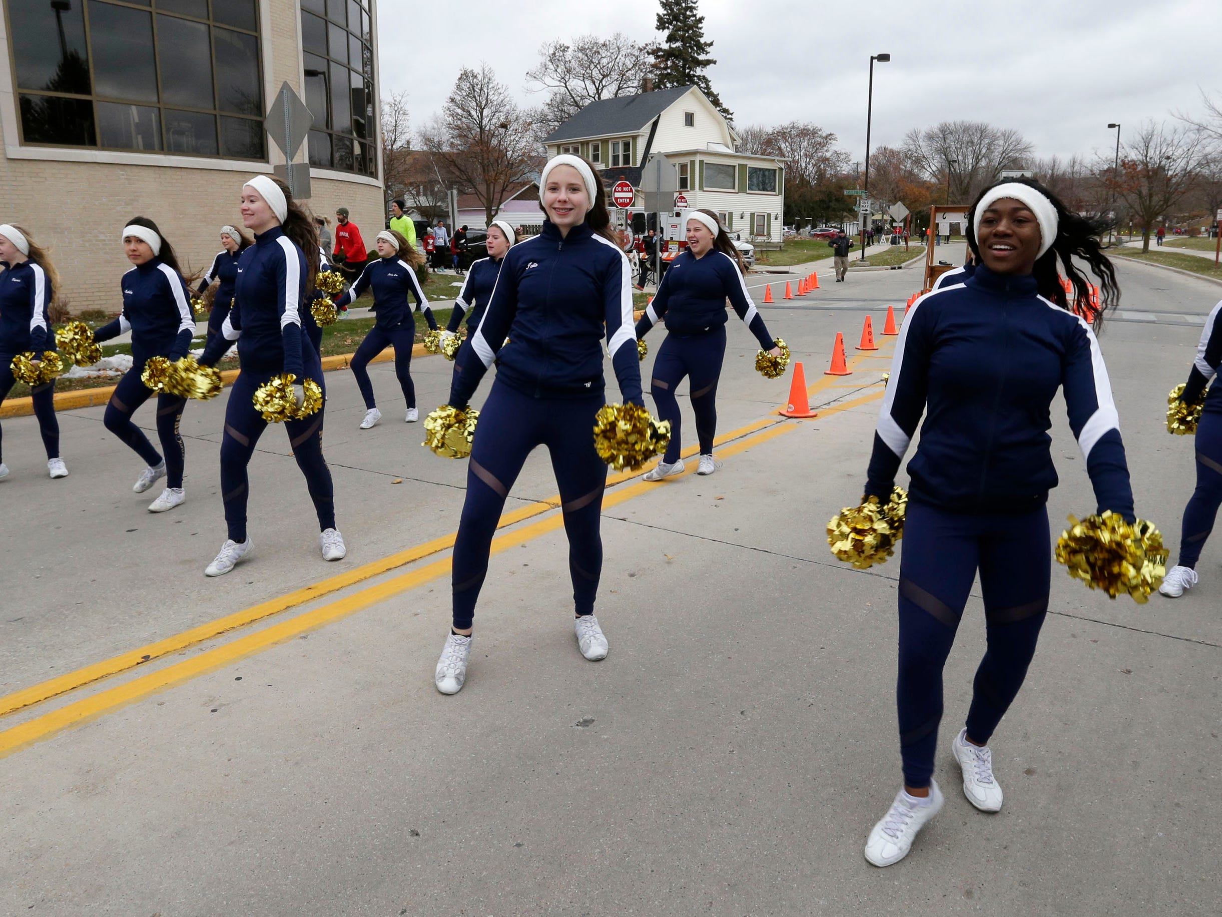 The Sheboygan North Dance team warms up the crowd before the Doug Opel Run for the Kids, Thursday, November 22, 2018, in Sheboygan, Wis.