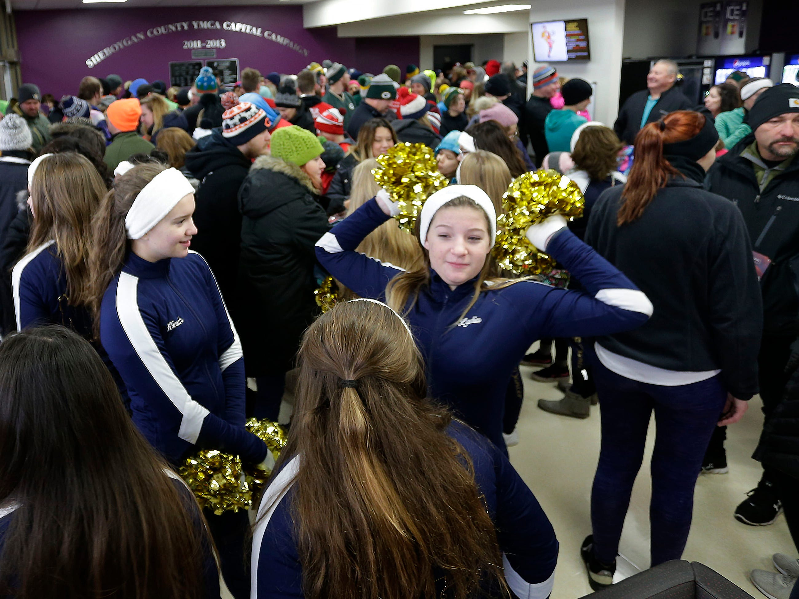 Sheboygan North Dance Team members stretch in the warm of the YMCA building before the Doug Opel Run for the Kids, Thursday, November 22, 2018, in Sheboygan, Wis.