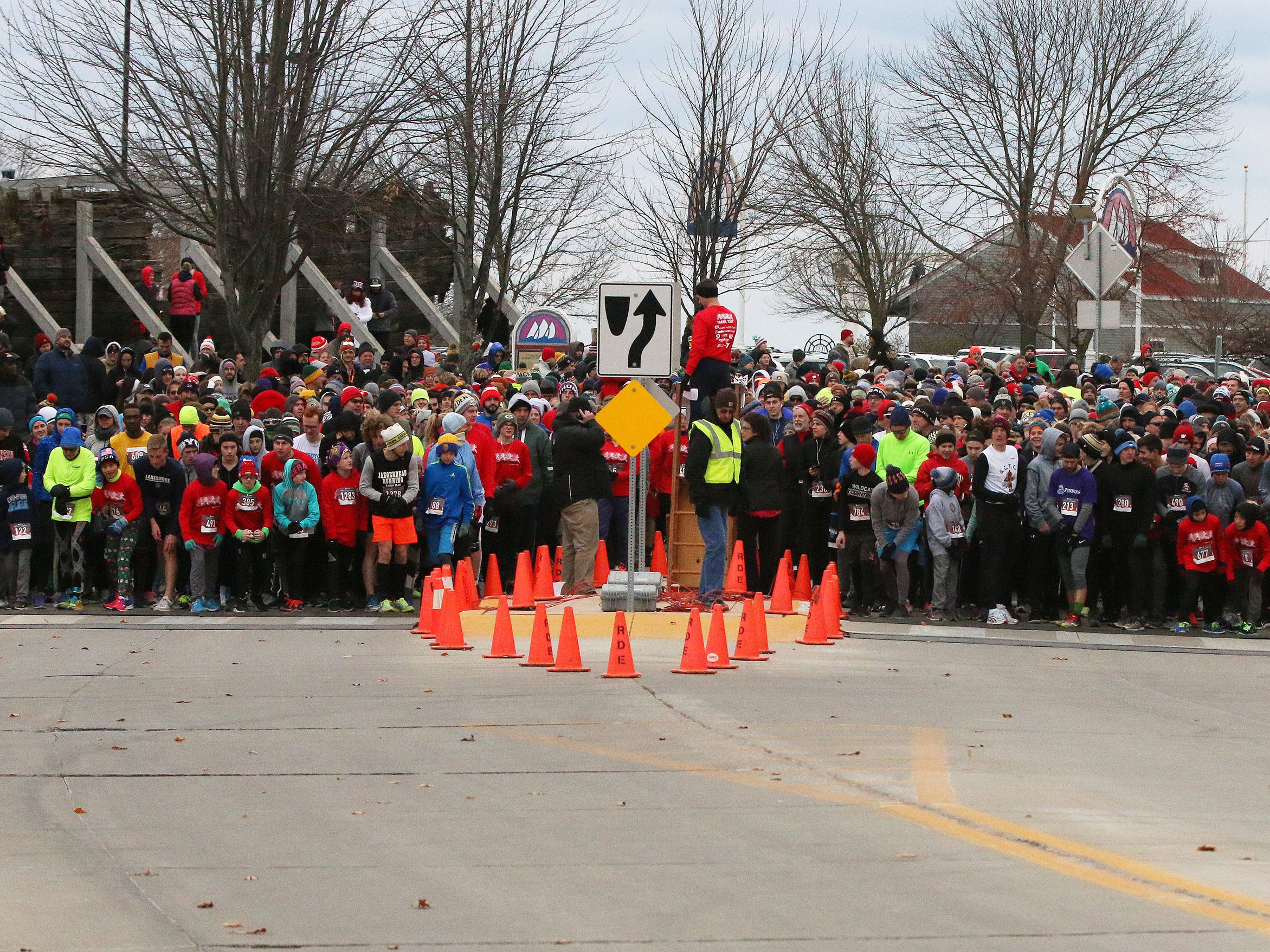 Runners line up at the Doug Opel Run for the Kids, Thursday, November 22, 2018, in Sheboygan, Wis.