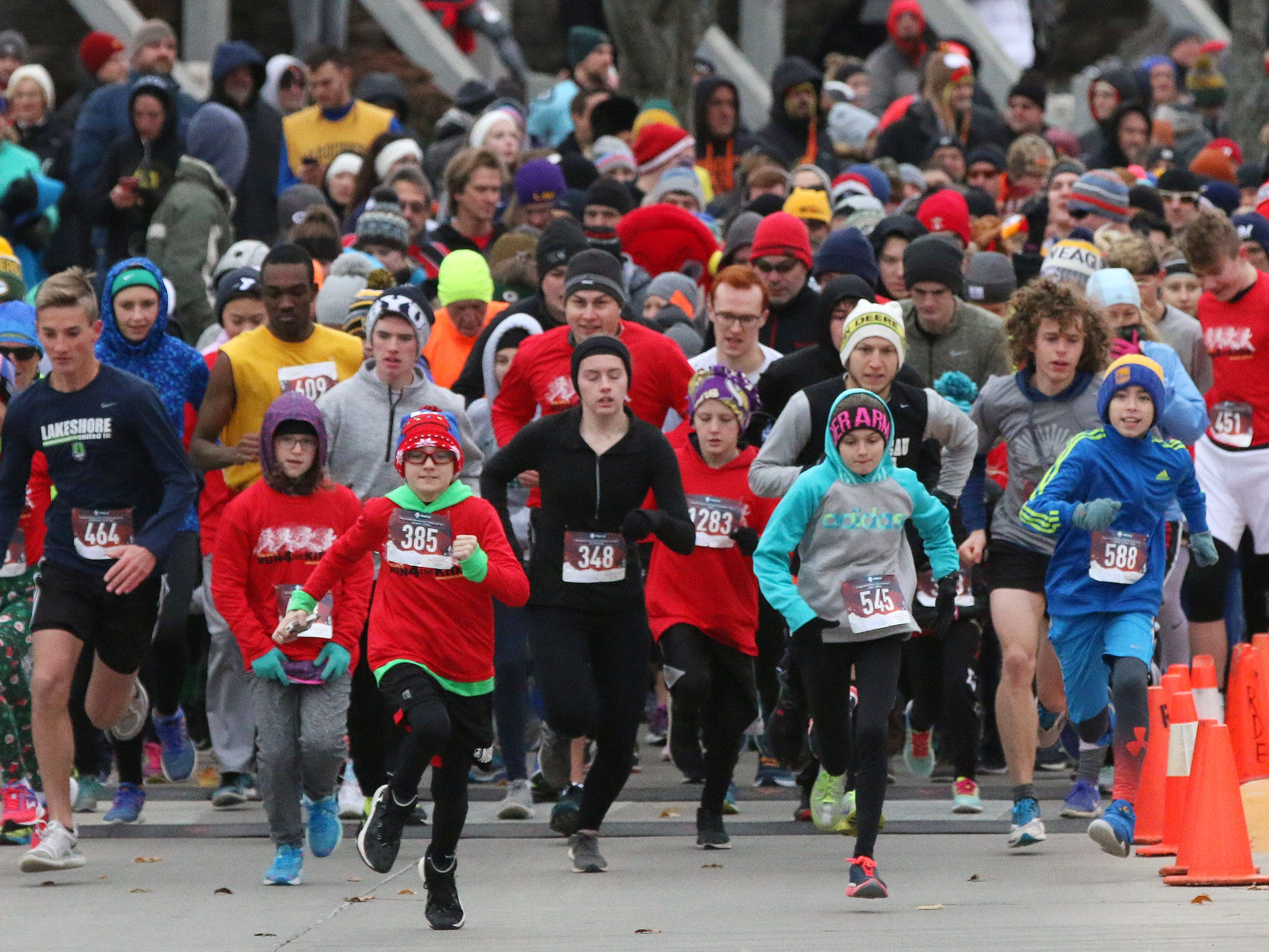 Runners begin the Doug Opel Run for the Kids, Thursday, November 22, 2018, in Sheboygan, Wis.