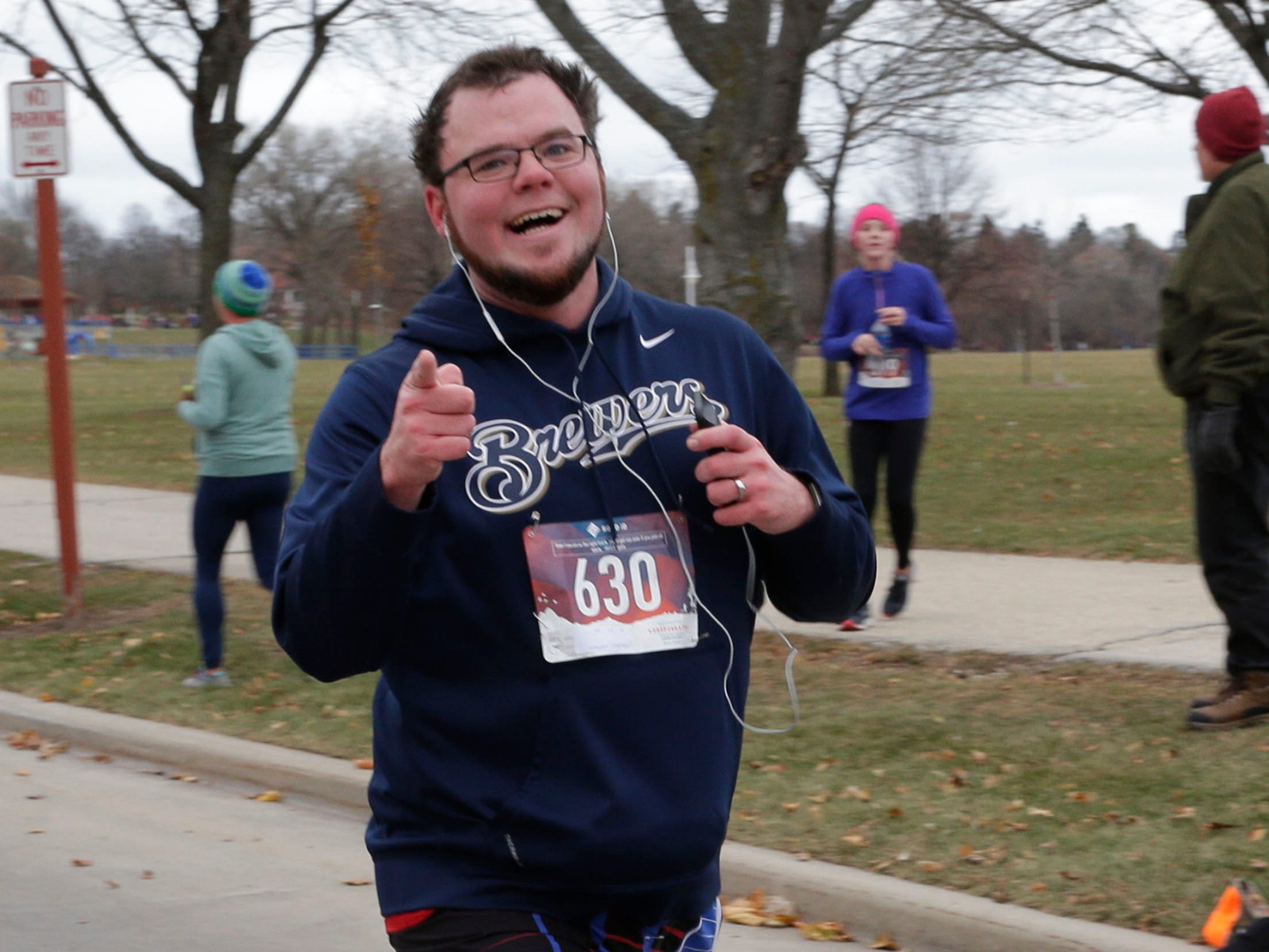 Nate Woefel reacts at the end of the Doug Opel Run for the Kids, Thursday, November 22, 2018, in Sheboygan, Wis.