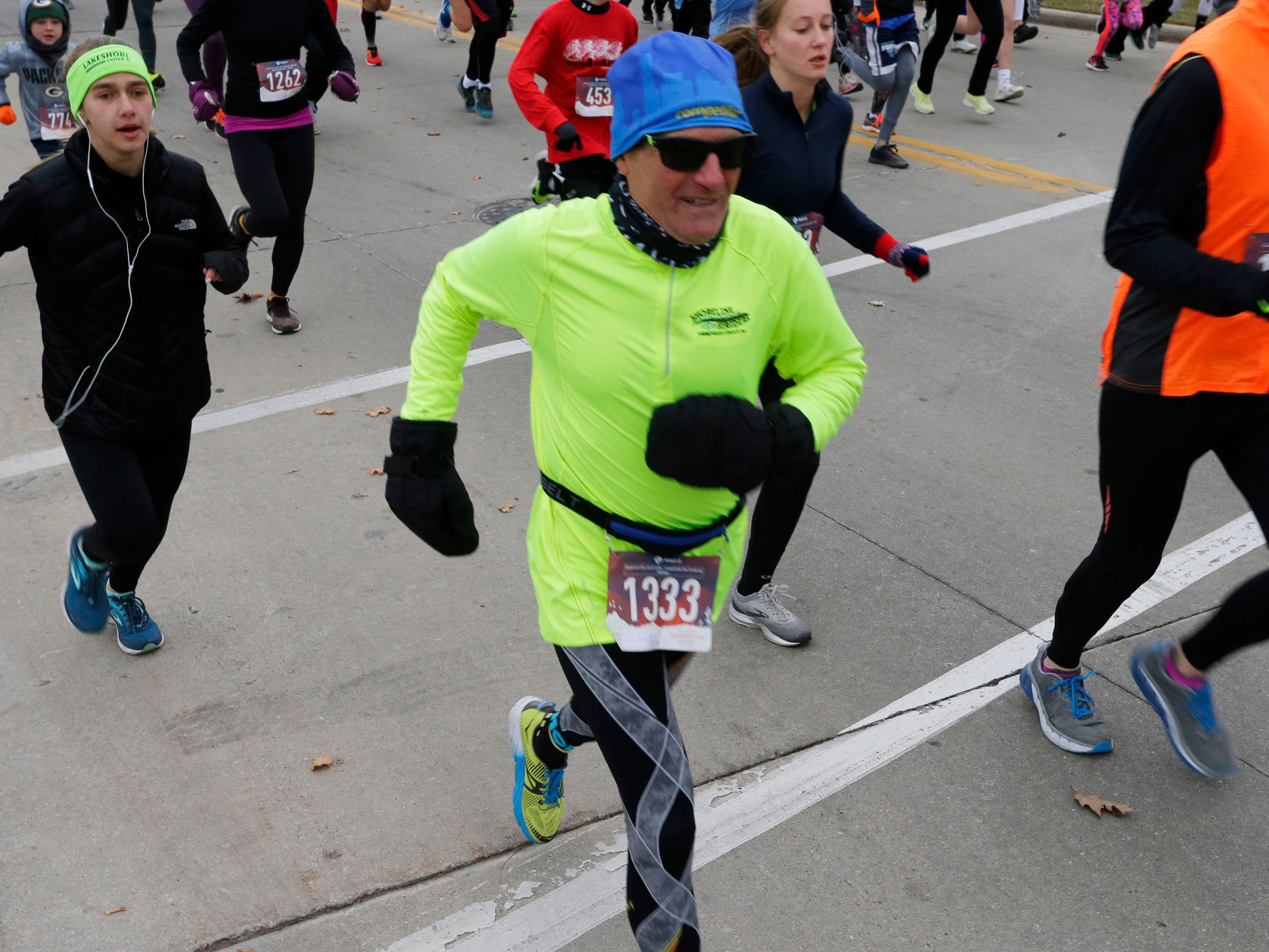 Sheboygan's well known runner Roy Pirrung (1333) at the start of the Doug Opel Run for the Kids, Thursday, November 22, 2018, in Sheboygan, Wis.