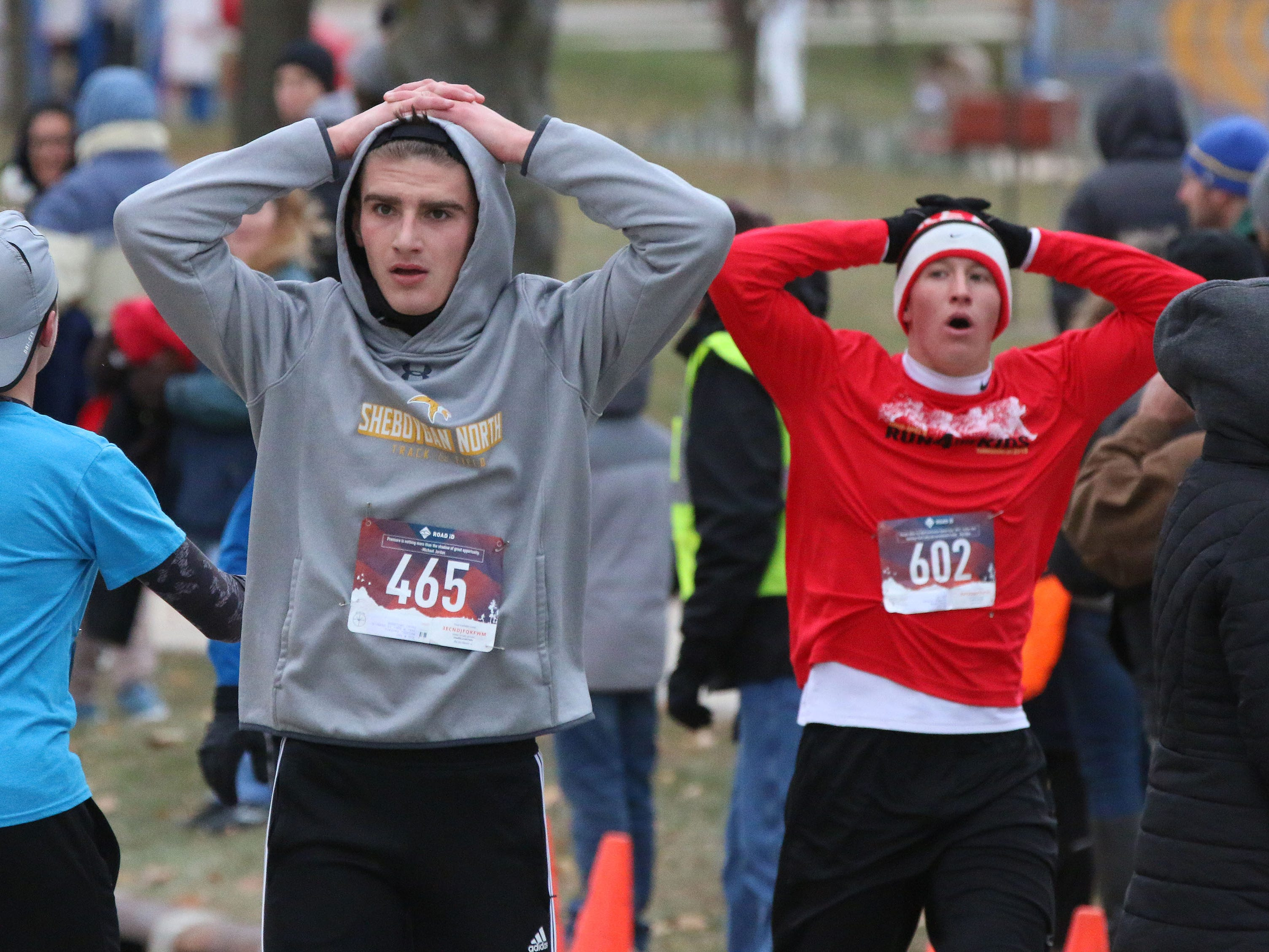 Runners work to recover following their run at the Doug Opel Run for the Kids, Thursday, November 22, 2018, in Sheboygan, Wis.