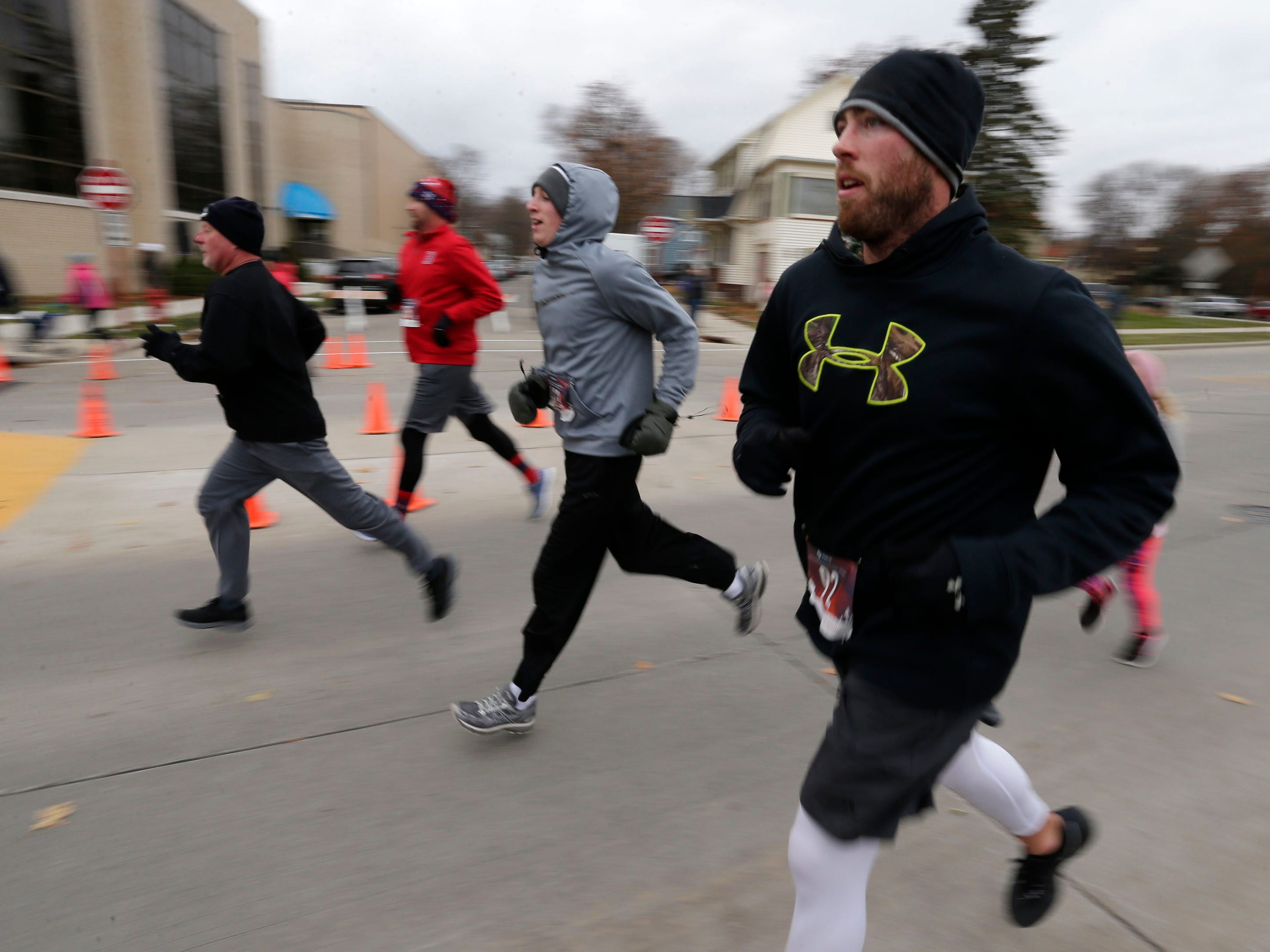 Runners enter the finish area at the Doug Opel Run for the Kids, Thursday, November 22, 2018, in Sheboygan, Wis.