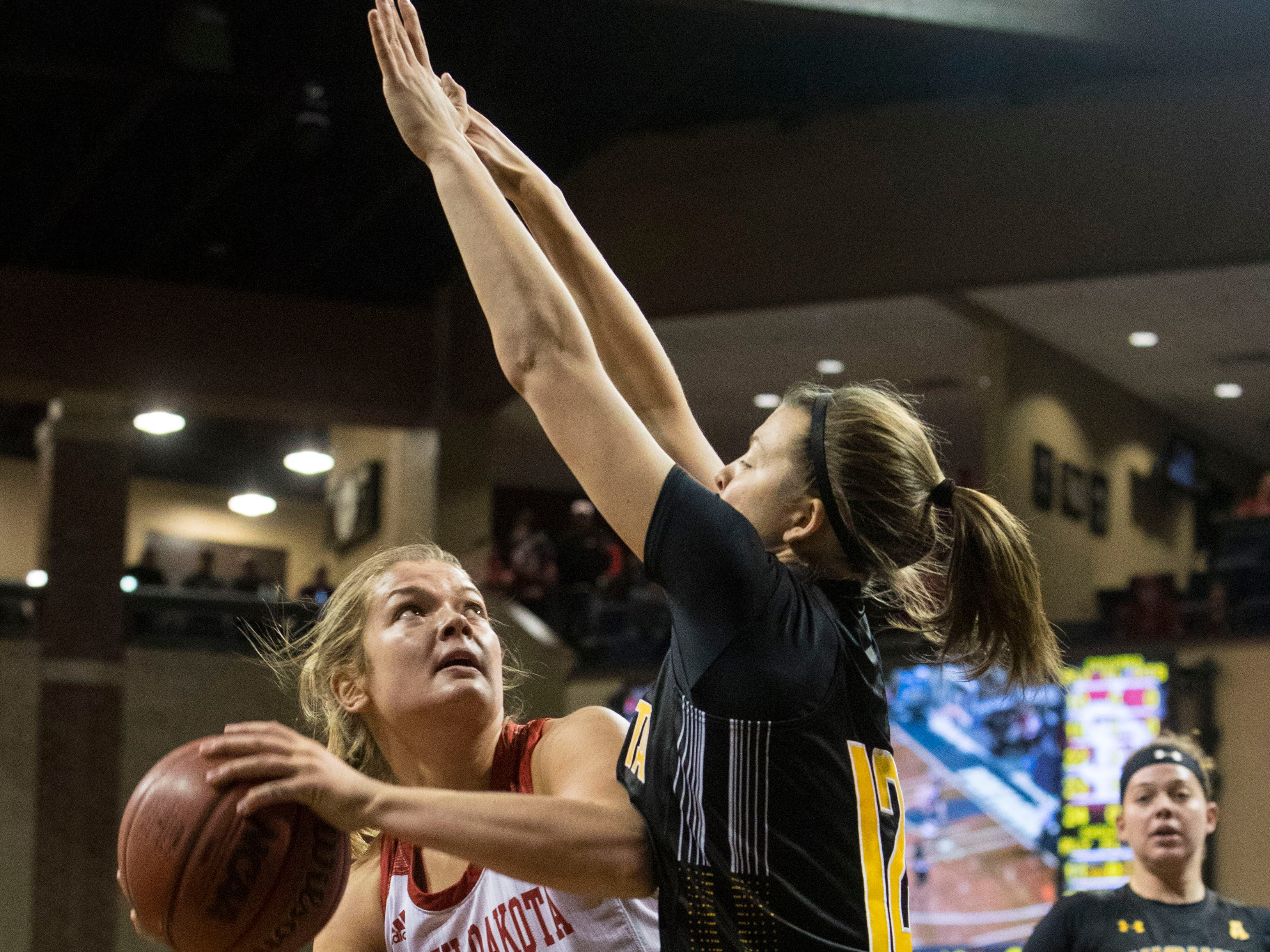 USD's Taylor Frederick (15) gets blocked by Wichita State player during a game at the Sanford Pentagon in Sioux Falls, S.D., Wednesday, Nov. 21, 2018.