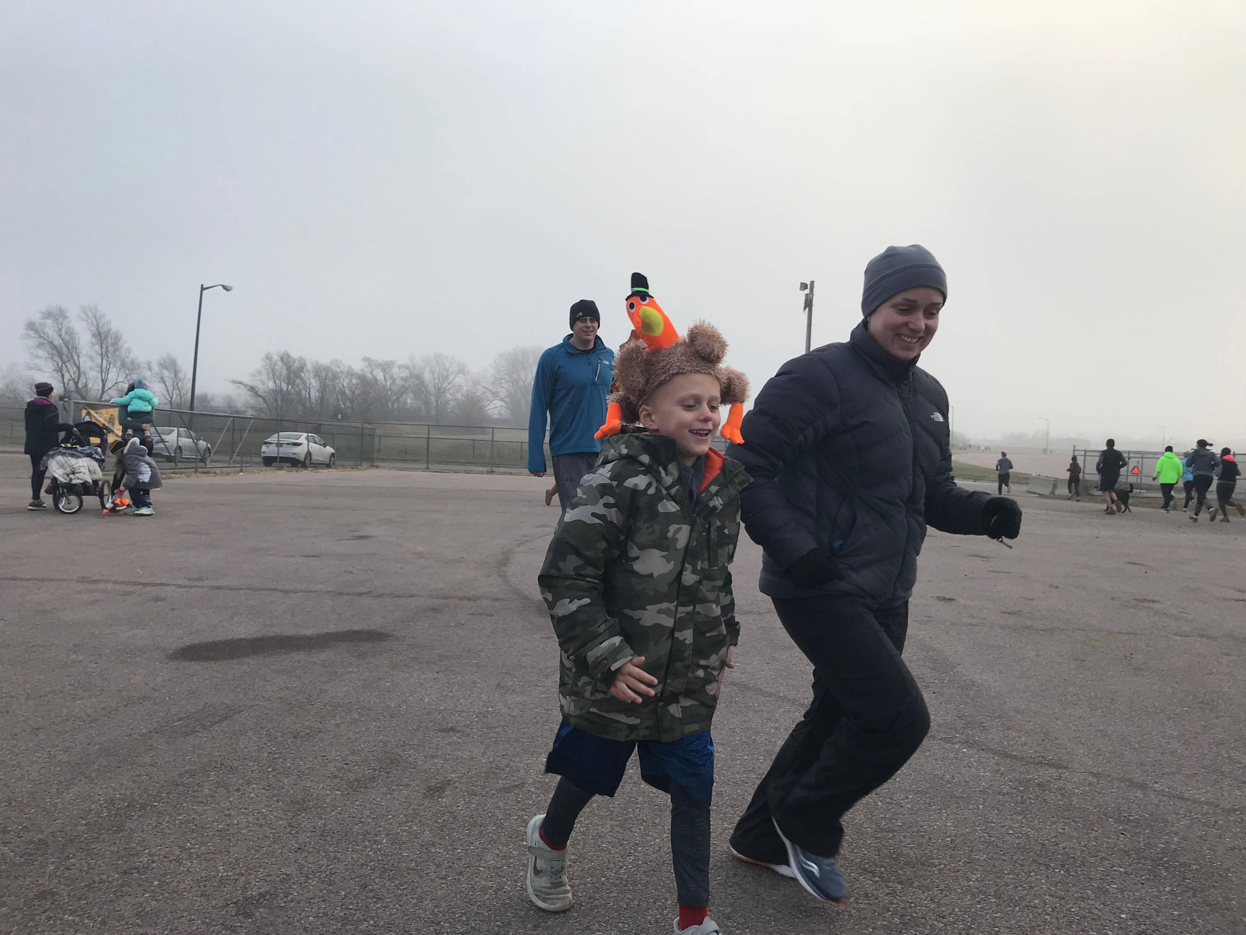 Brady Zirbel, 7, runs with his mother Leigh at the starting area of the 2018 Run for Food. The event benefits the Banquet, which serves hot meals to Sioux Falls' hungry.