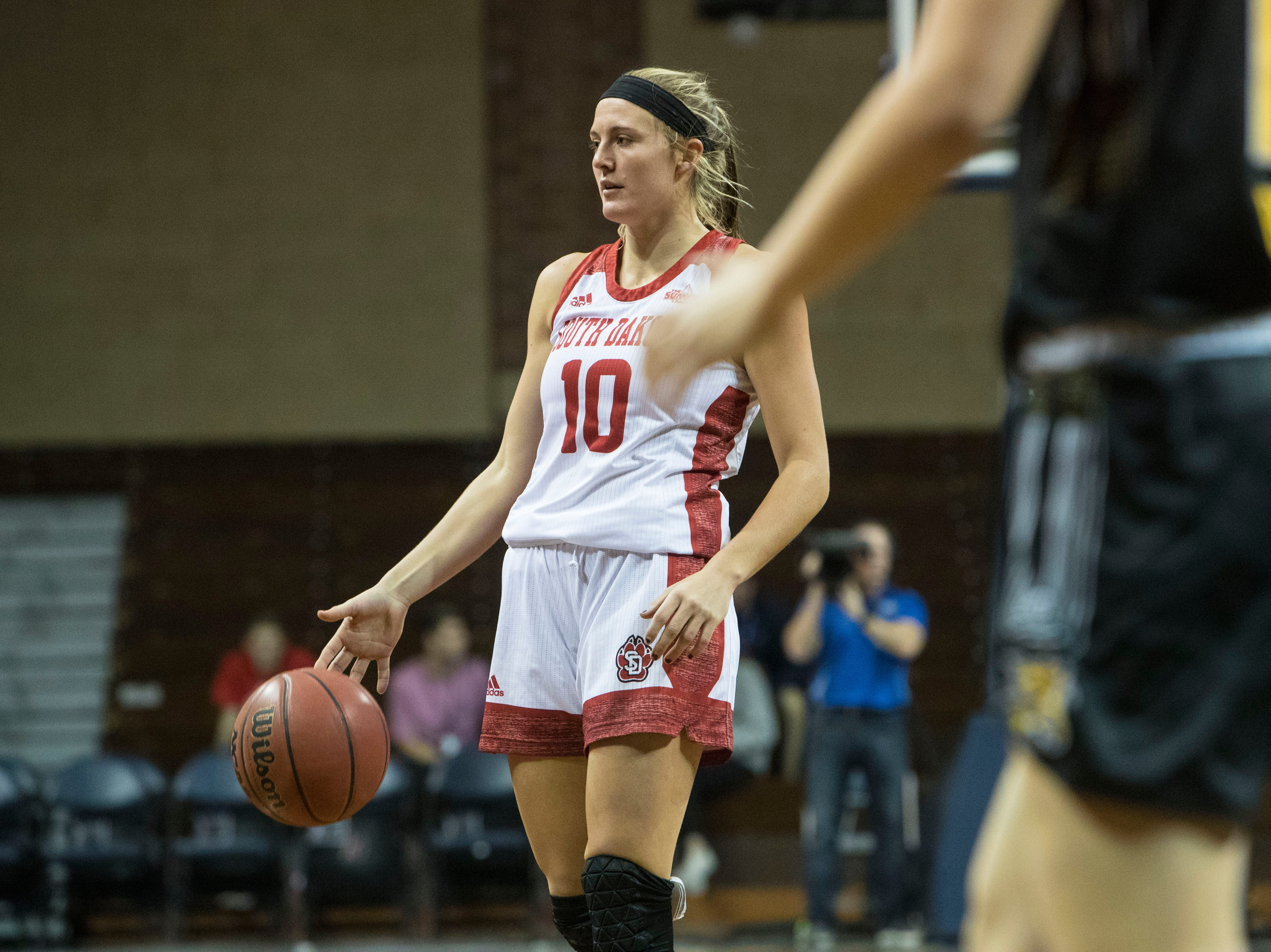 USD's Allison Arens (10) looks to pass the ball during a game against Wichita State at the Sanford Pentagon in Sioux Falls, S.D., Wednesday, Nov. 21, 2018.