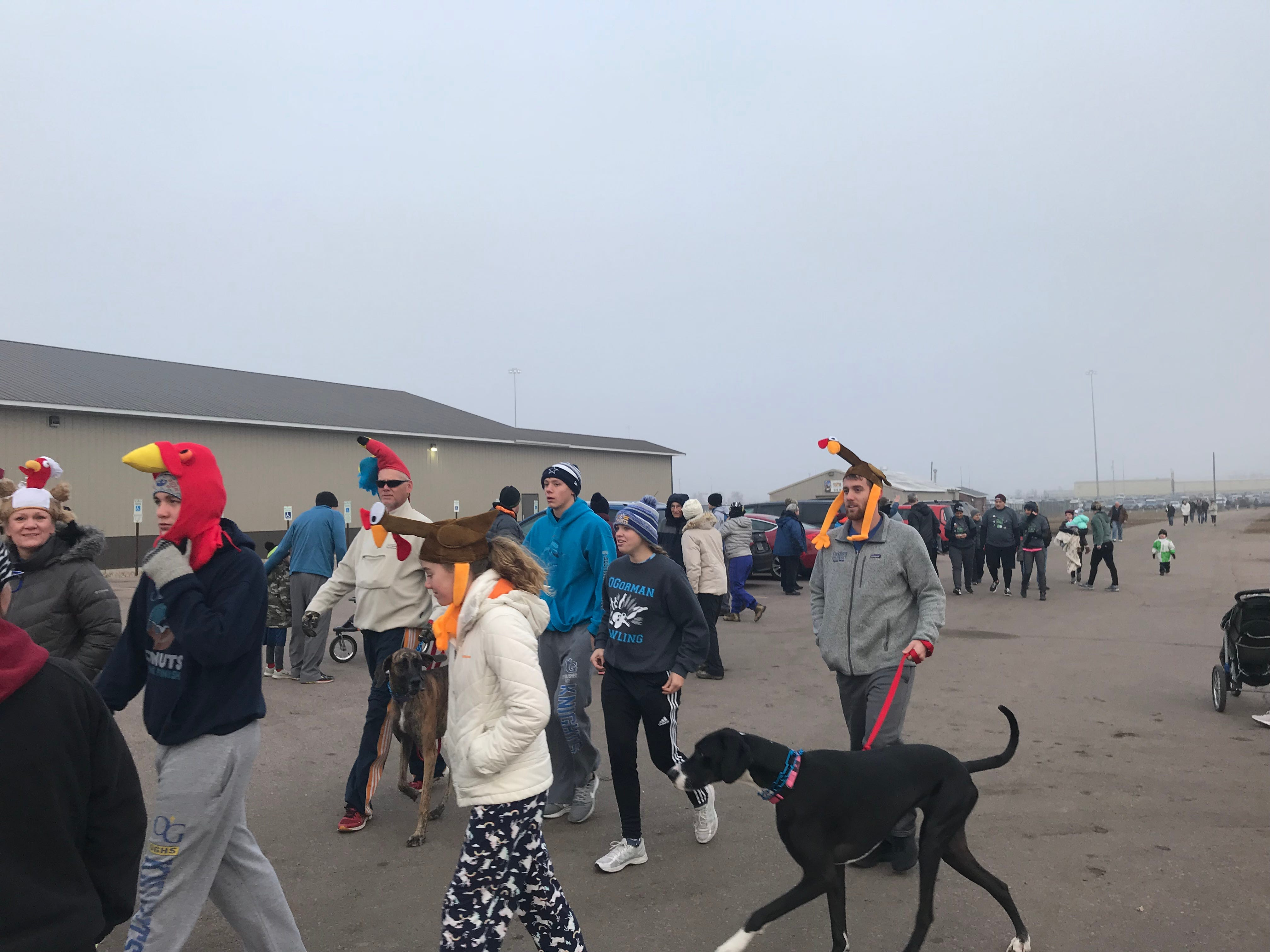 A group of runners arrive in turkey hats for the 2018 Run for Food. The event benefits the Banquet, which serves hot meals to Sioux Falls' hungry.