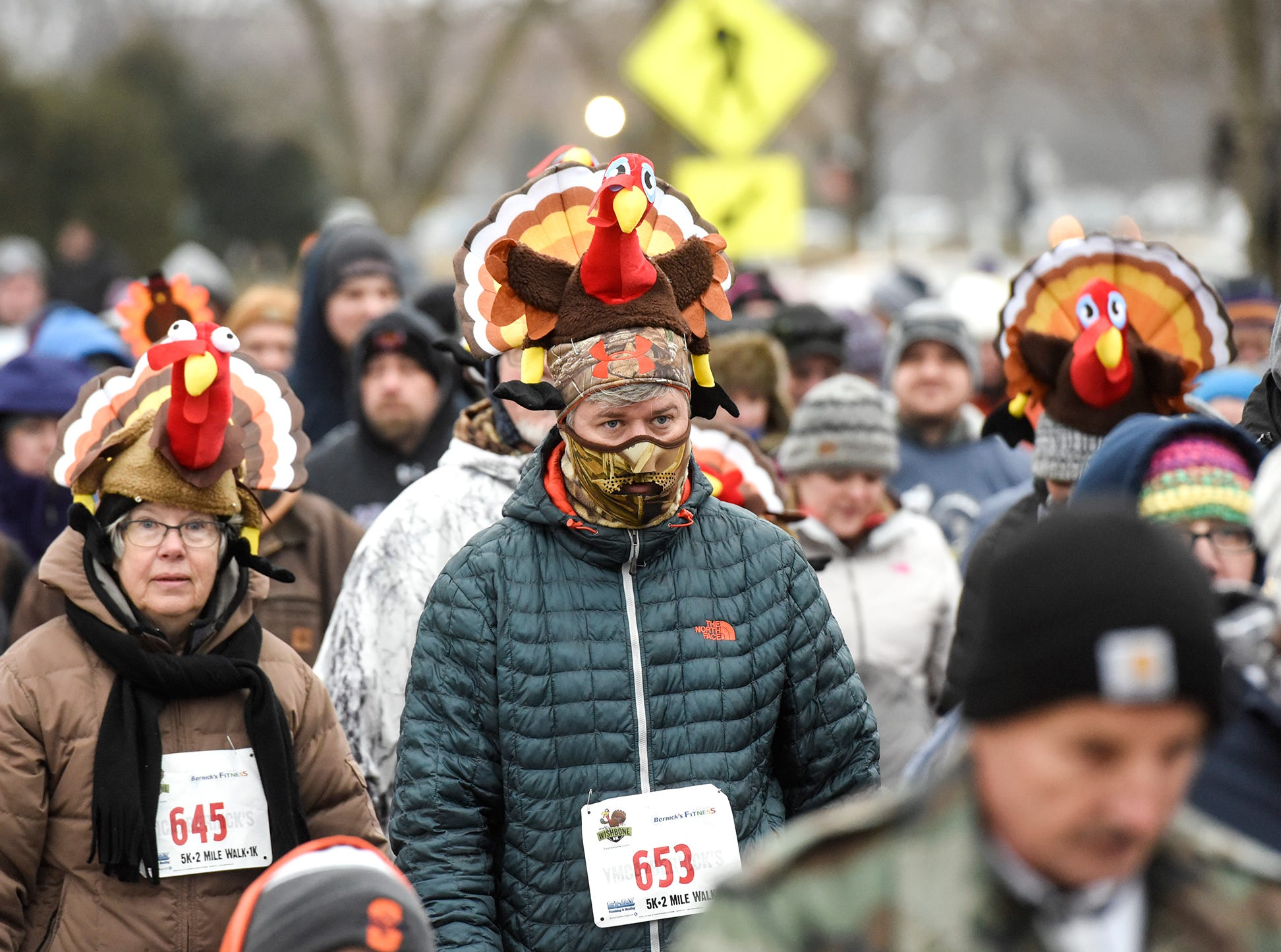 Runners sport their turkey hats during the Wishbone 5K Thursday, Nov. 22, at the St. Cloud Area Family YMCA.