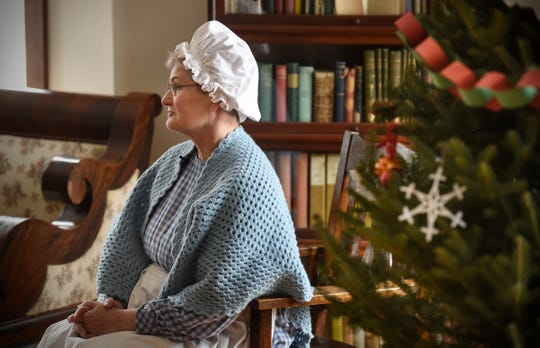 """Margaret Lundberg talks about holiday preparations while in character as Mrs. Lindbergh Wednesday, Nov. 21, as part of the Charles Lindbergh House and Museum's """"A WWI Christmas"""" event in Little Falls."""