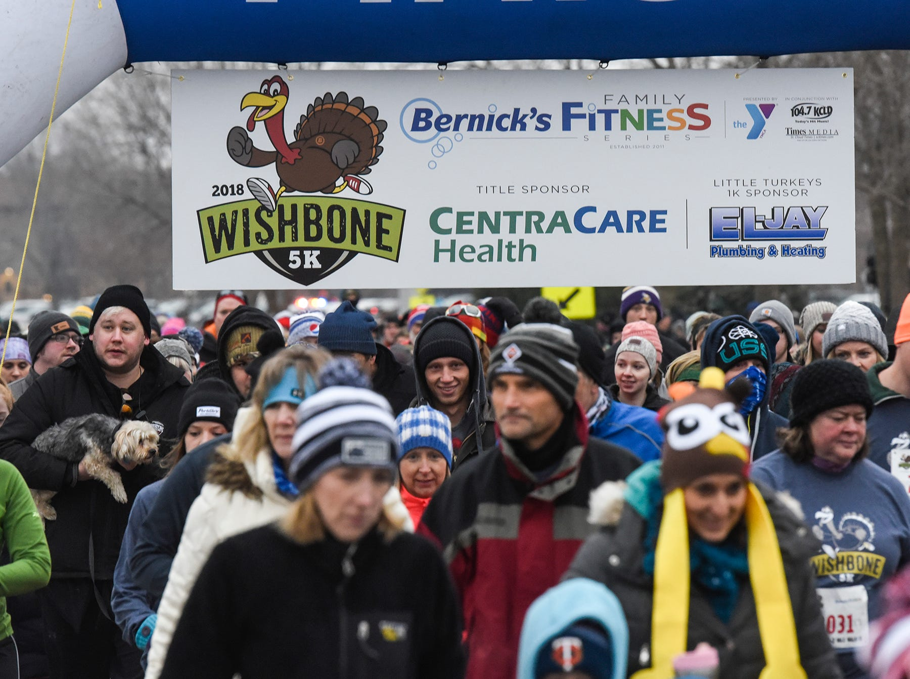 Runners leave the starting line during the Wishbone 5K Thursday, Nov. 22, at the St. Cloud Area Family YMCA.