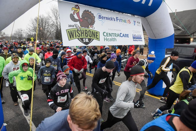 Runners leave the starting line during the Wishbone 5K Thursday, Nov. 22, at the St. Cloud Area Family YMCA. Nearly 5,000 runners had registered for the annual event.