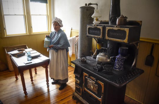 """Margaret Lundberg talks about the effects of rationing and supply on holiday meals while in character as Mrs. Lindbergh Wednesday, Nov. 21, as part of the Charles Lindbergh House and Museum's """"A WWI Christmas"""" event in Little Falls."""