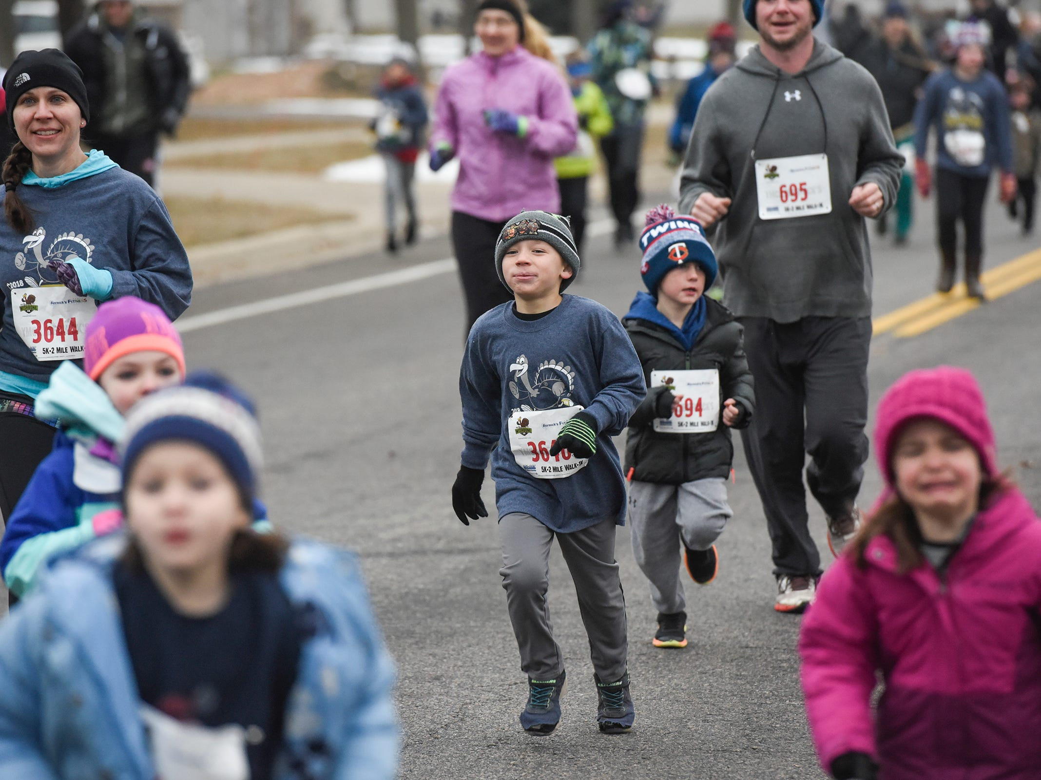 Kids run participants approach the finish line during the Wishbone 5K Thursday, Nov. 22, at the St. Cloud Area Family YMCA.